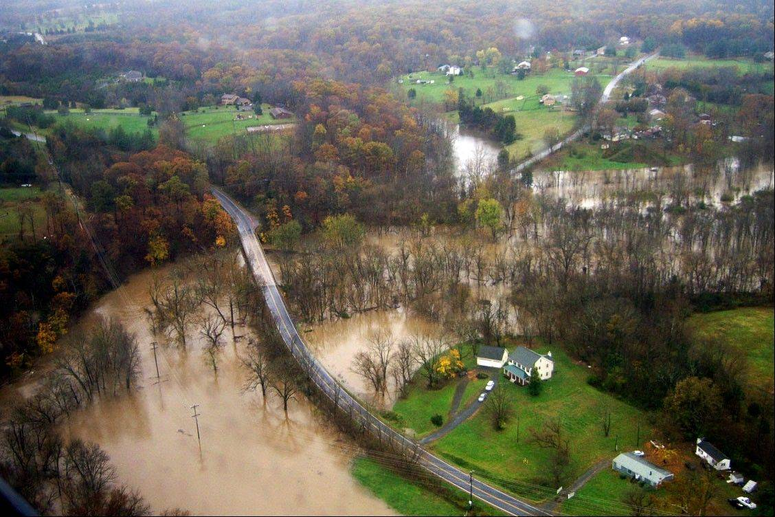 This image provided by the Virginia State Police shows the Potomac River flooding along Evergreen Watson Road in Loudon County Va., Tuesday Oct. 30, 2012. People in the coastal corridor battered by superstorm Sandy took the first cautious steps Wednesday to reclaim routines upended by the disaster, even as rescuers combed neighborhoods strewn with debris and scarred by floods and fire.