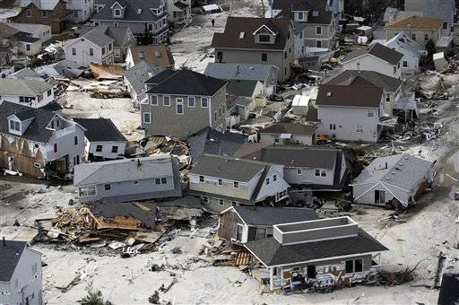 This aerial photo shows destroyed homes left in the wake of superstorm Sandy on Wednesday, Oct. 31, 2012, in Seaside Heights, N.J. New Jersey got the brunt of Sandy, which made landfall in the state and killed six people. More than 2 million customers were without power as of Wednesday afternoon, down from a peak of 2.7 million.