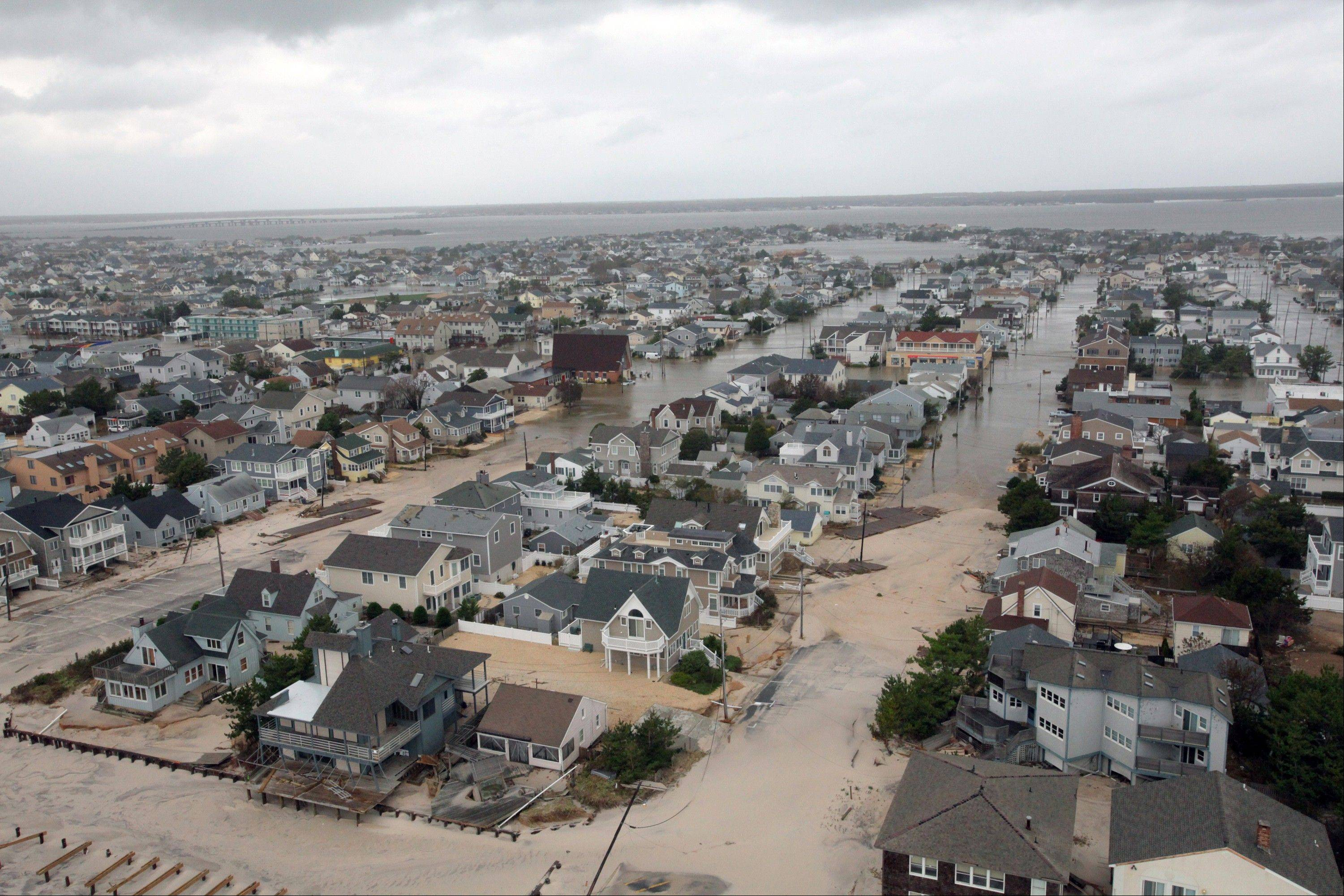 This Tuesday, Oct. 30, 2012 an aerial photo provided by the U.S. Air Force shows damage to the New Jersey shoreline during a search, taken during a search and rescue mission by 1-150 Assault Helicopter Battalion, New Jersey Army National Guard. By late Tuesday, the winds and flooding inflicted by the fast-weakening superstorm Sandy had subsided, leaving at least 55 people dead along the Atlantic Coast and splintering beachfront homes and boardwalks from the mid-Atlantic states to southern New England.