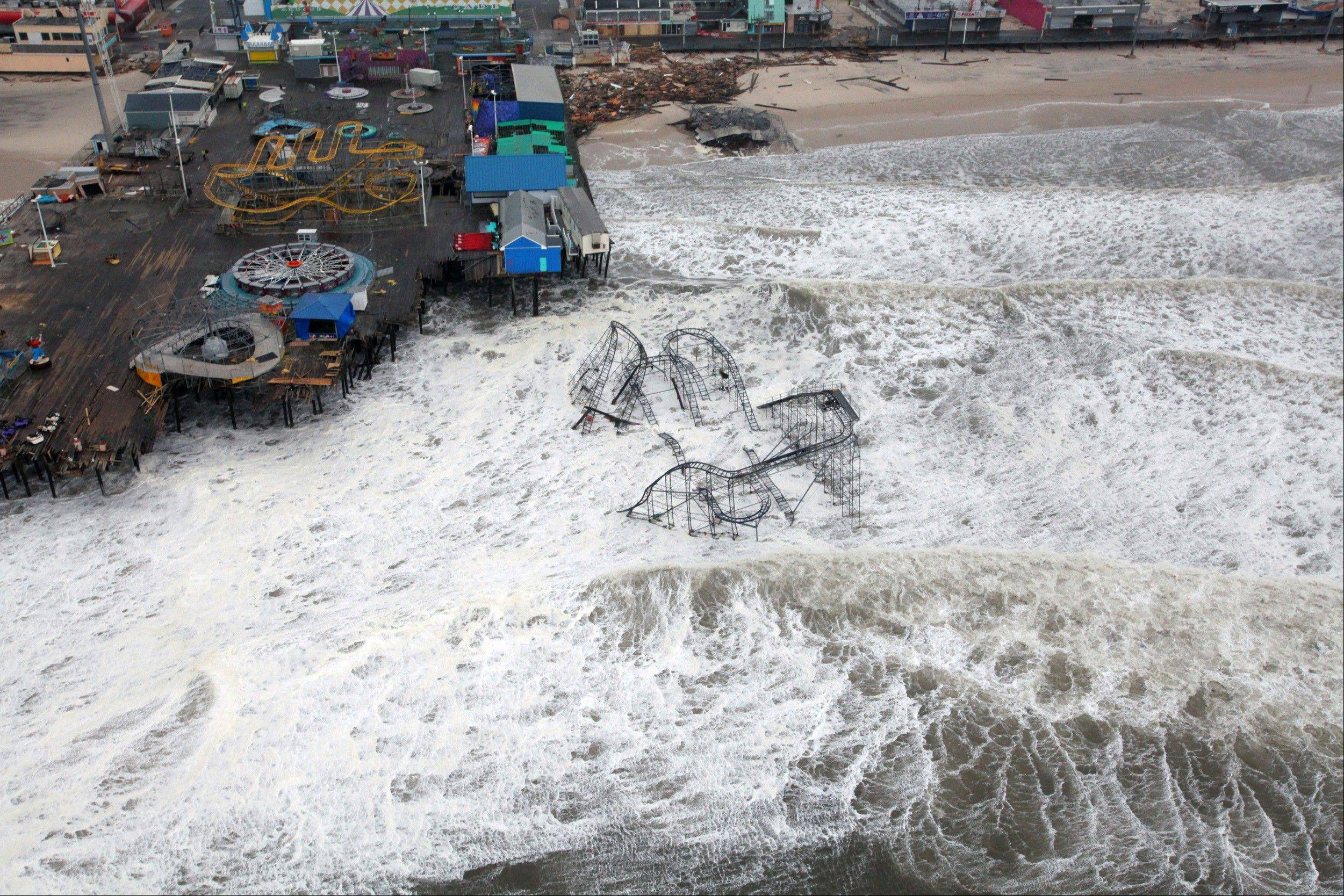 This Tuesday, Oct. 30, 2012 photo provided by the U.S. Air Force shows an aerial view of the roller coaster from the Seaside Heights amusement park on the New Jersey shore submerged in surf, taken during a search and rescue mission by 1-150 Assault Helicopter Battalion, New Jersey Army National Guard. By late Tuesday, the winds and flooding inflicted by the fast-weakening superstorm Sandy had subsided, leaving at least 55 people dead along the Atlantic Coast and splintering beachfront homes and boardwalks from the mid-Atlantic states to southern New England.