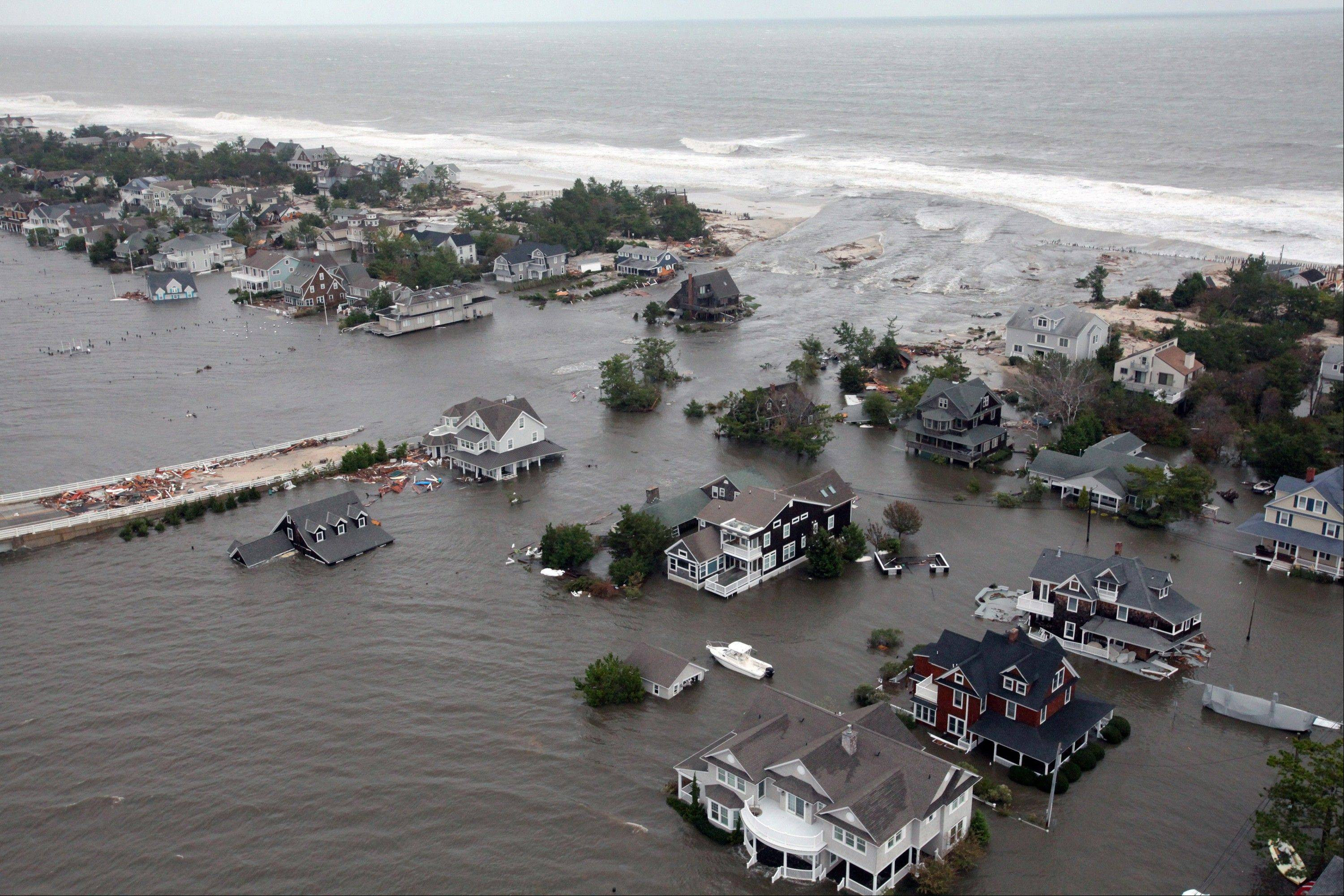 This Oct. 30, 2012 aerial photo provided by the U. S. Air Force shows flooding on the New Jersey shoreline during a search and rescue mission by 1-150 Assault Helicopter Battalion, New Jersey Army National Guard. By late Tuesday, the winds and flooding inflicted by the fast-weakening Superstorm Sandy had subsided, leaving at least 55 people dead along the Atlantic Coast and splintering beachfront homes and boardwalks from the mid-Atlantic states to southern New England.