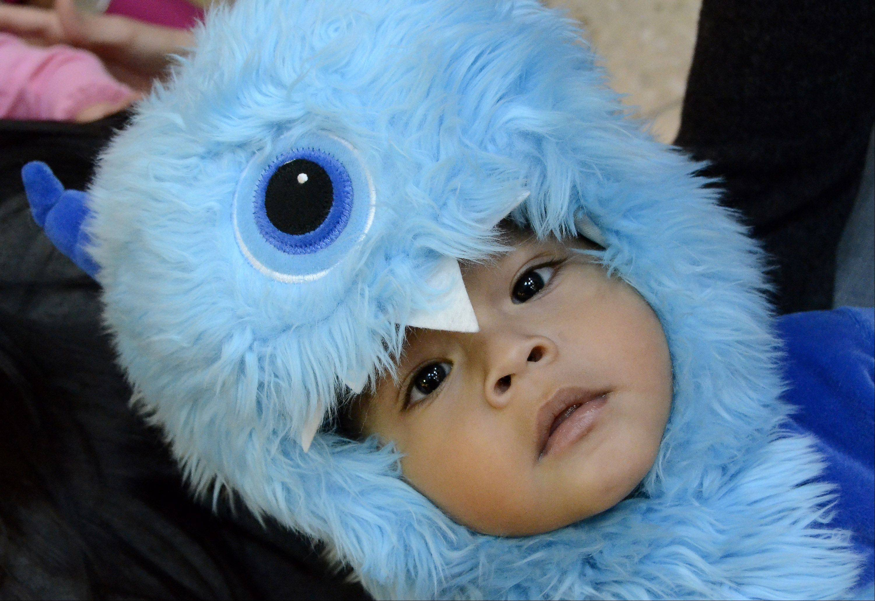 Thiago Cardoso, 17 months, of Elgin keeps an eye out Wednesday morning at the Halloween Bash hosted by the Woodfield Mall in Schaumburg.