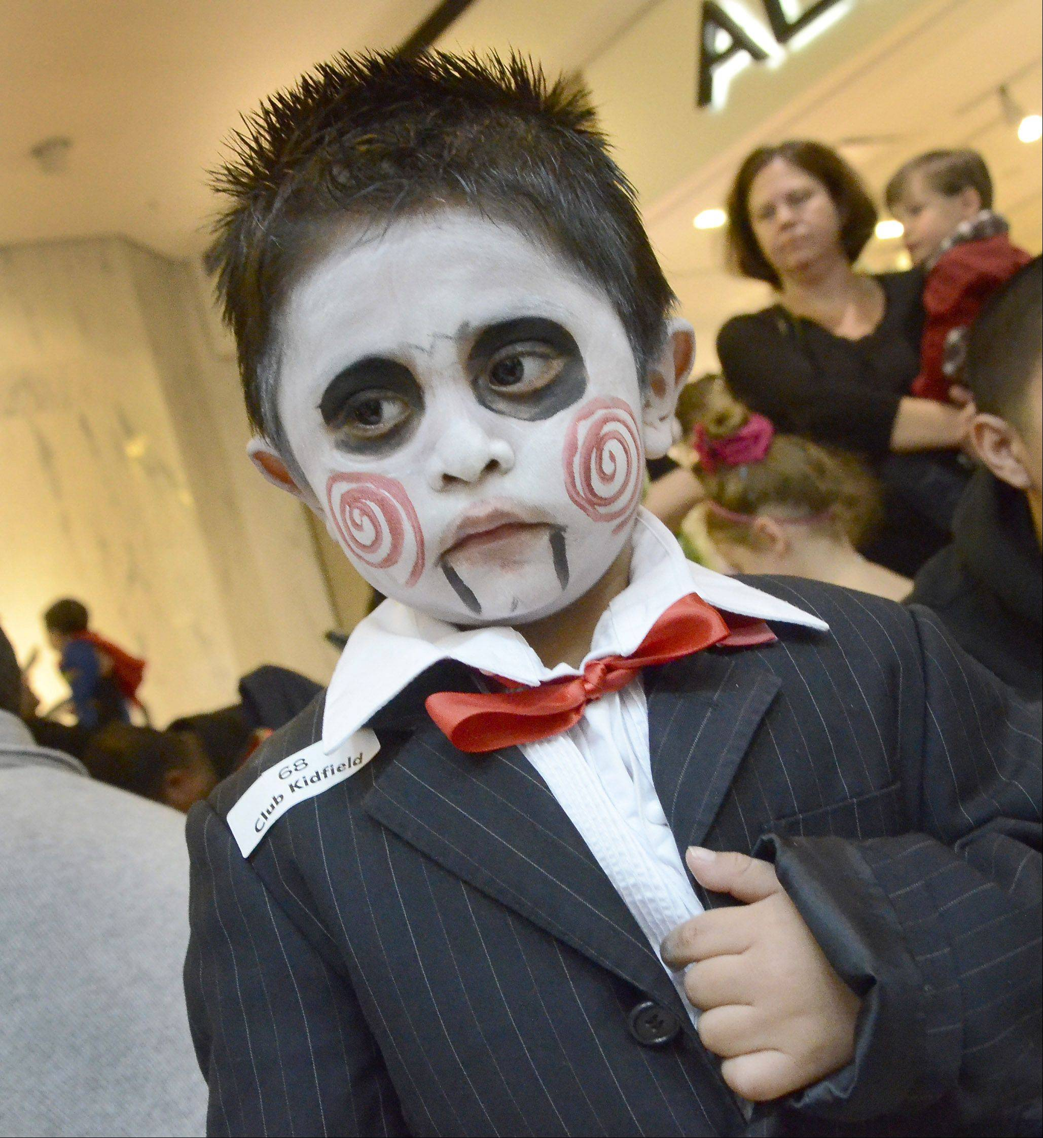 Elesvan Reyes, 2, of Wheeling, appears to be looking for his next victim during the Halloween Bash hosted Wednesday by the Woodfield Mall in Schaumburg.