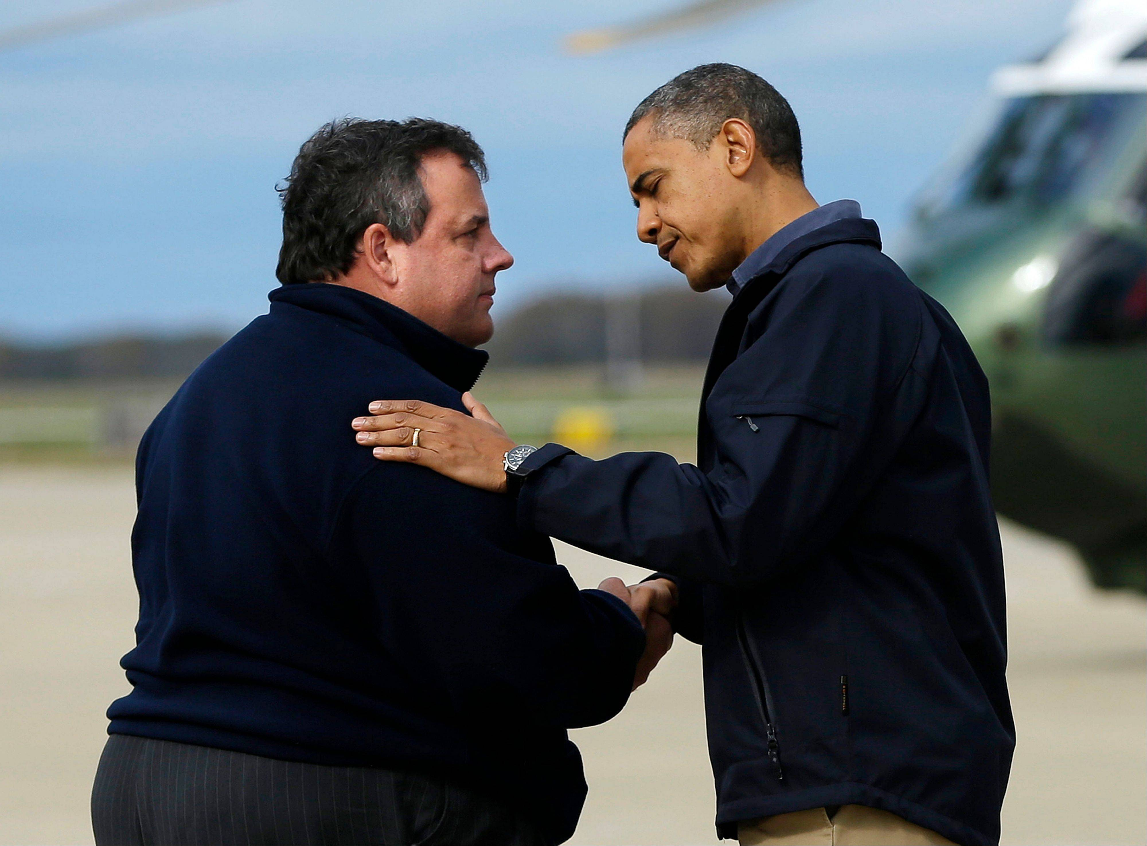 President Barack Obama is greeted by New Jersey Gov. Chris Christie upon his arrival at Atlantic City International Airport Wednesday. Obama traveled to region to take an aerial tour of the Atlantic Coast in New Jersey in areas damaged by superstorm Sandy.