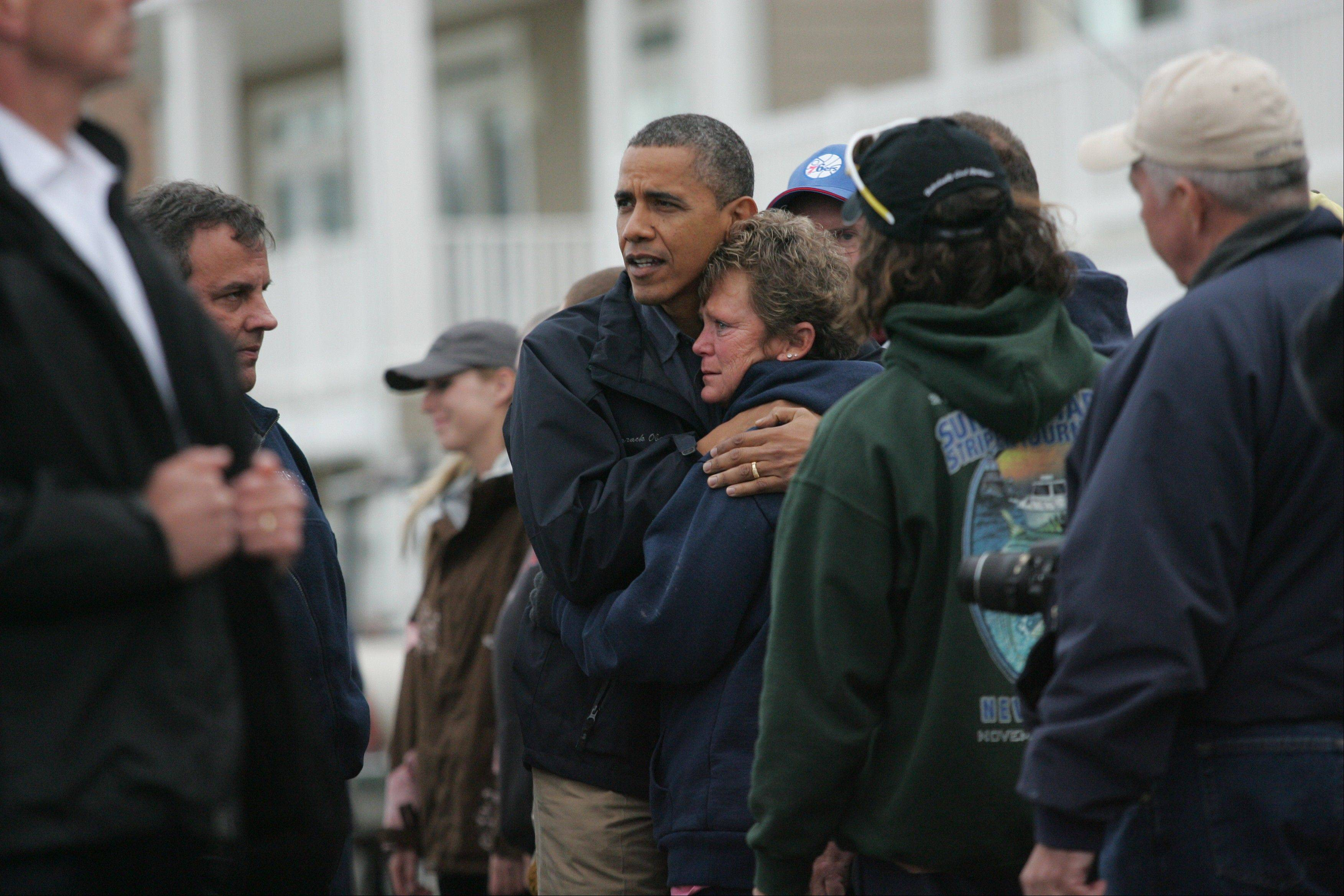 President Barack Obama embraces Donna Vanzant during a tour of a neighborhood affected by superstorm Sandy on Wednesday in Brigantine, N.J. Vanzant is a owner of North Point Marina, which was damaged by the storm.