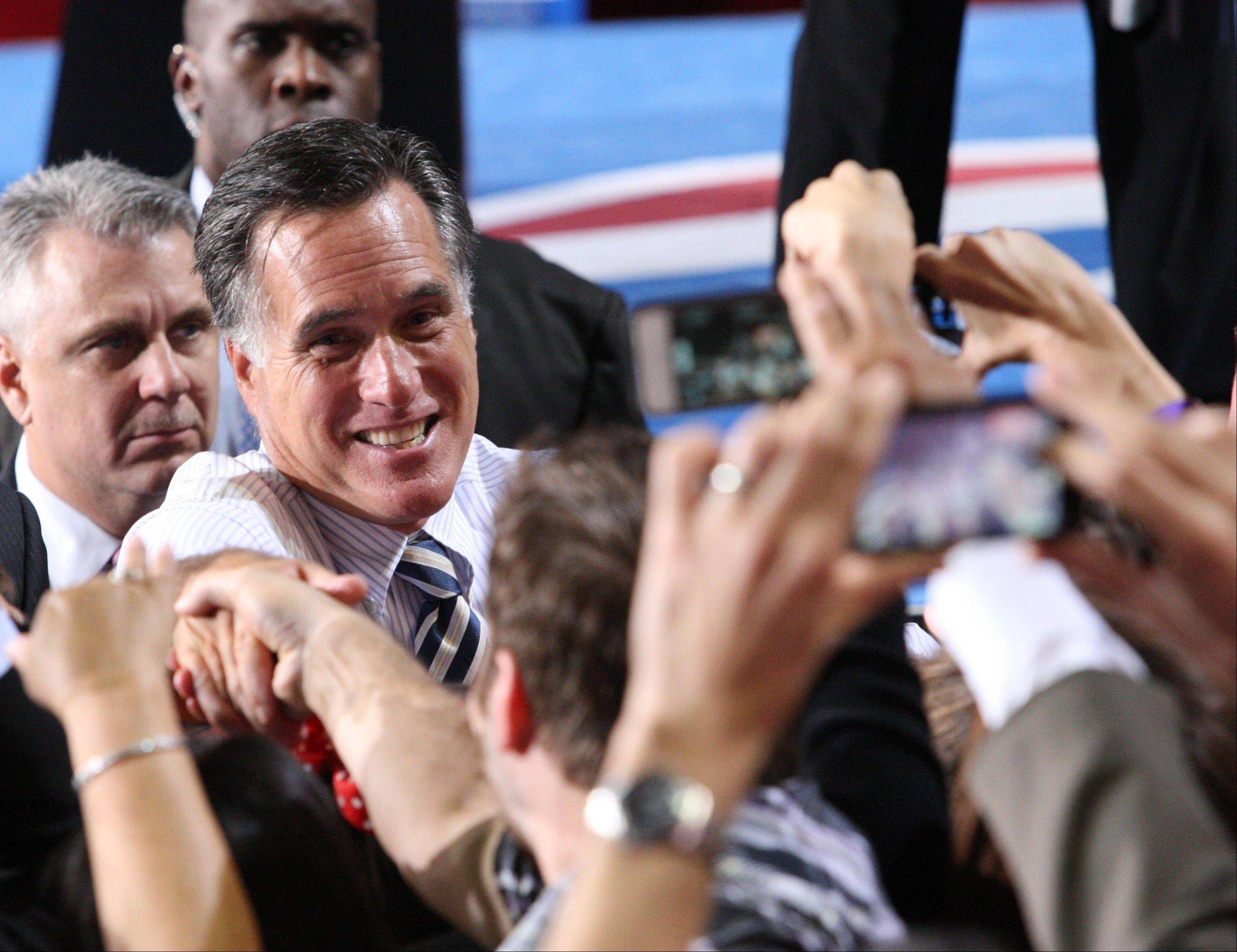 Republican presidential candidate Mitt Romney shakes hands at a campaign event at the University of Miami on Wednesday in Coral Gables, Fla.