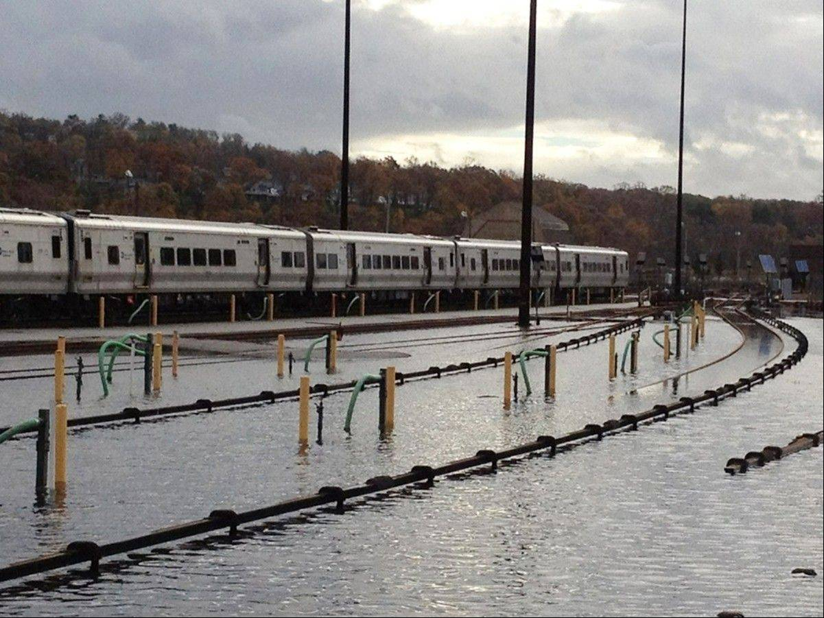 In a photo made available by the Metropolitan Transportation Authority, trains stand in a flooded Metro-North's Harmon Yard, Wednesday morning, Oct. 31, 2012, on the Hudson Line, in Croton-on-Hudson, New York in the aftermath of superstorm Sandy.