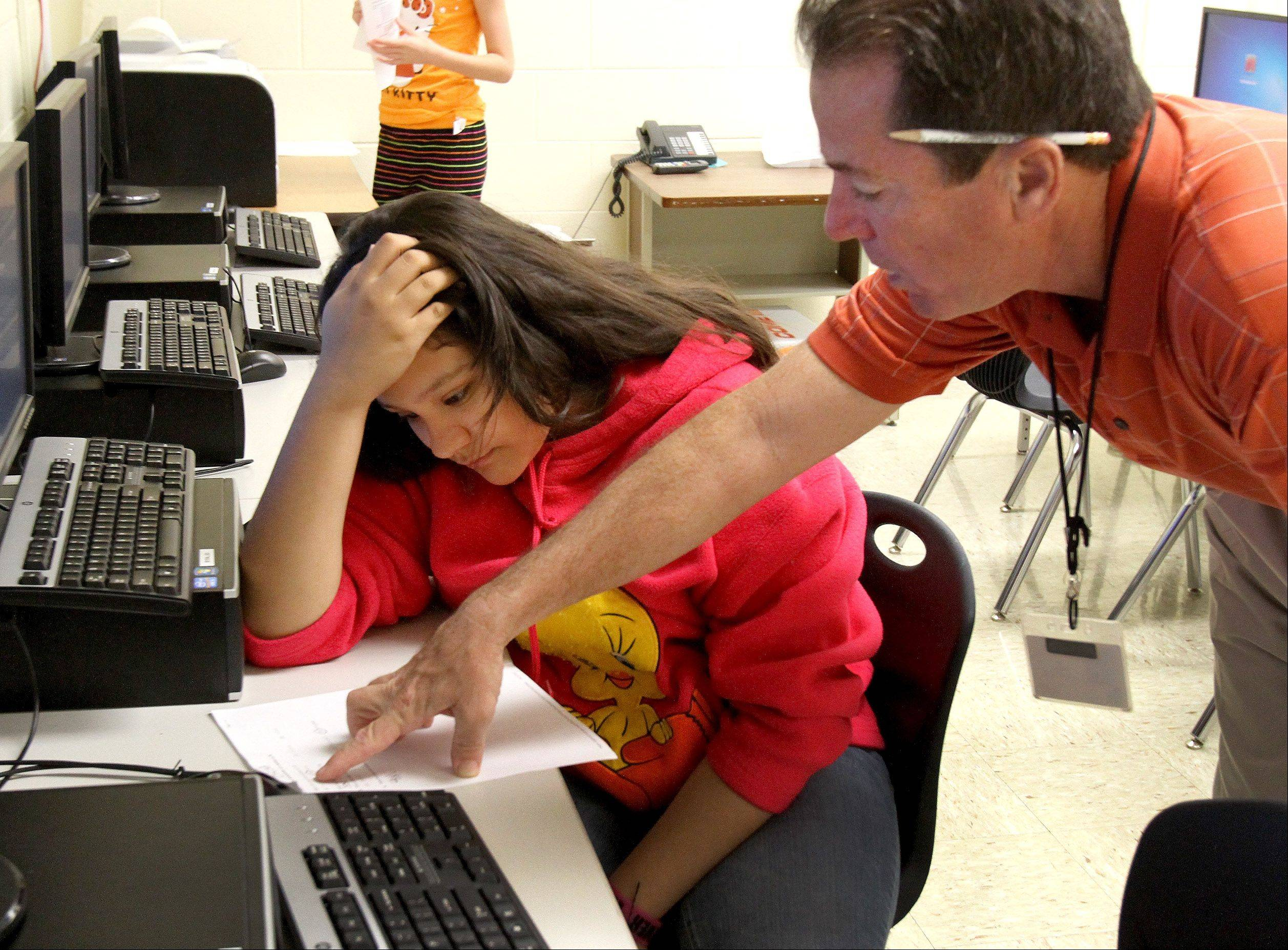 Teacher Rick Feffer goes over a problem with sixth-grader Brisa Robles in strategic math class at Benjamin Middle School in West Chicago. The school is part of one district among only six in the Daily Herald's DuPage County coverage area to make adequate yearly progress under No Child Left Behind this year.