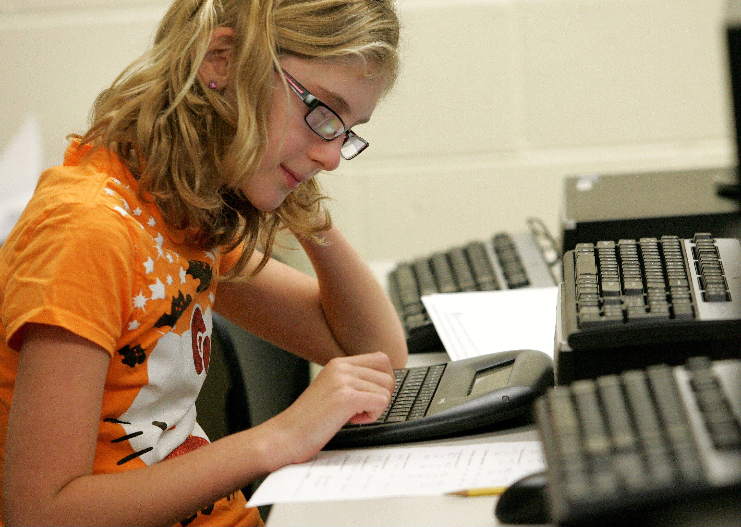 Sarah Lighthiser, a sixth grader at Benjamin Middle School in West Chicago, looks over a problem in strategic math class.
