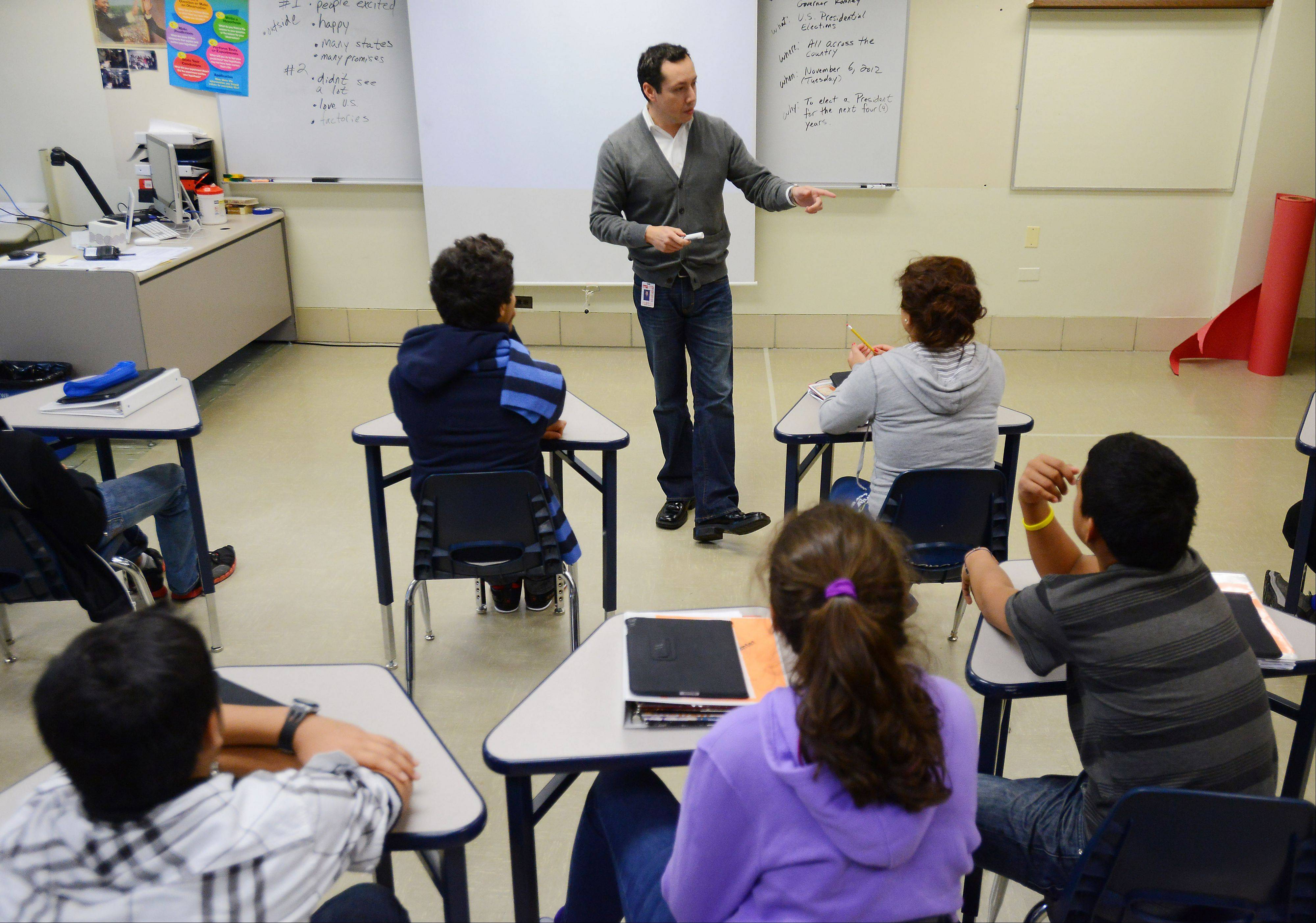 District 214 students new to the U.S. study at the Newcomer Center in Arlington Heights, where they take Mario Perez's social science class, among others. Students stay at the Center for one or two semesters before moving to their regular high school.