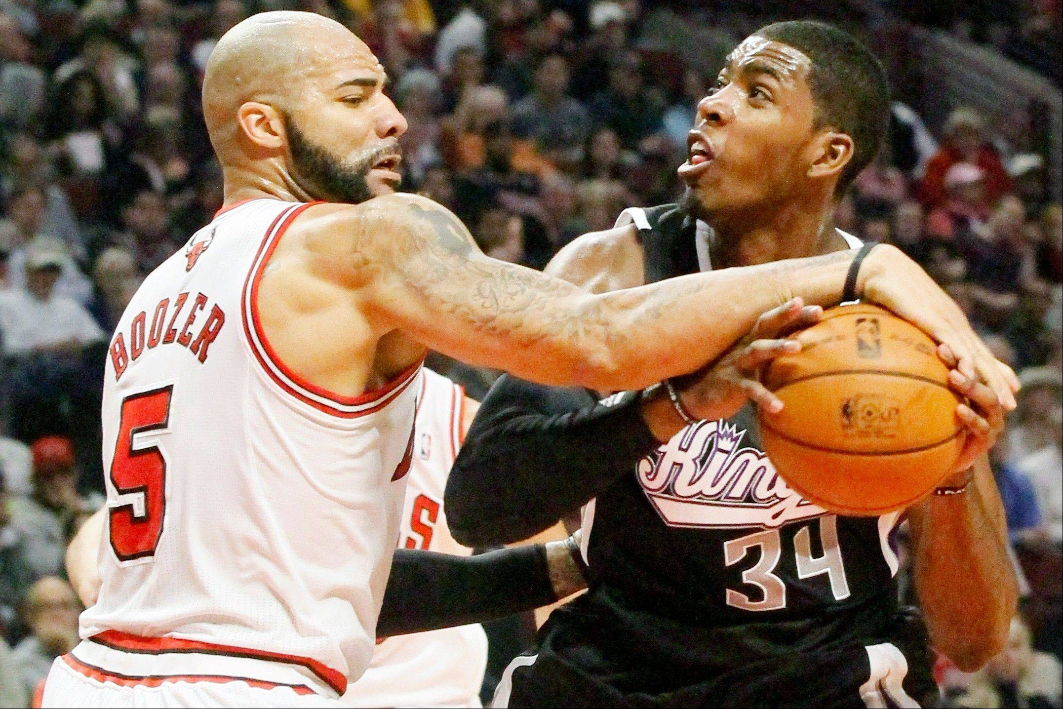 Bulls forward Carlos Boozer knocks the ball out of the hands of Sacramento Kings forward Jason Thompson during the first half Wednesday night.