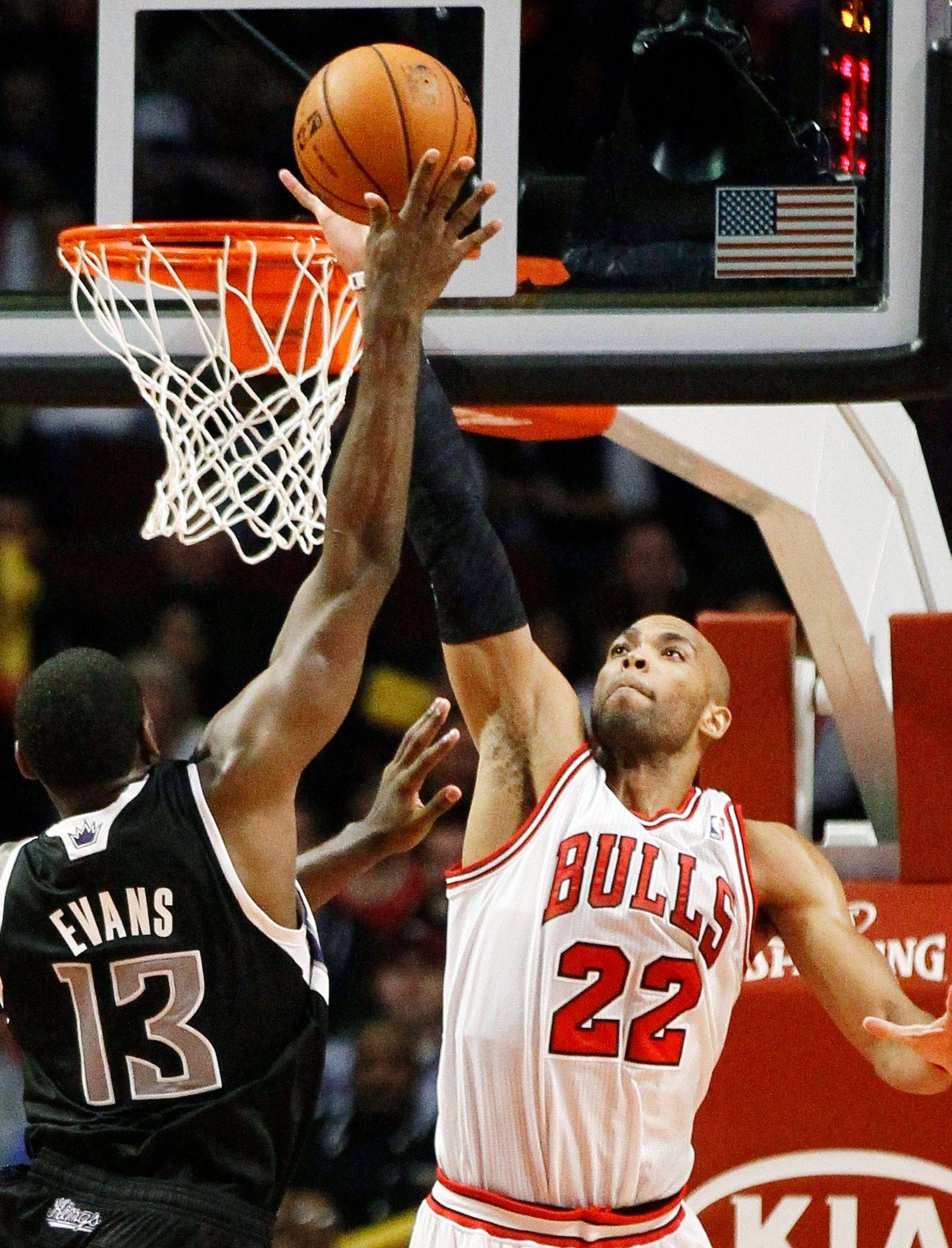 The Bulls' Taj Gibson, here challenging a shot by the Kings' Tyreke Evans on Wednesday, signed a four-year contract extension worth a reported $38 million with incentives.