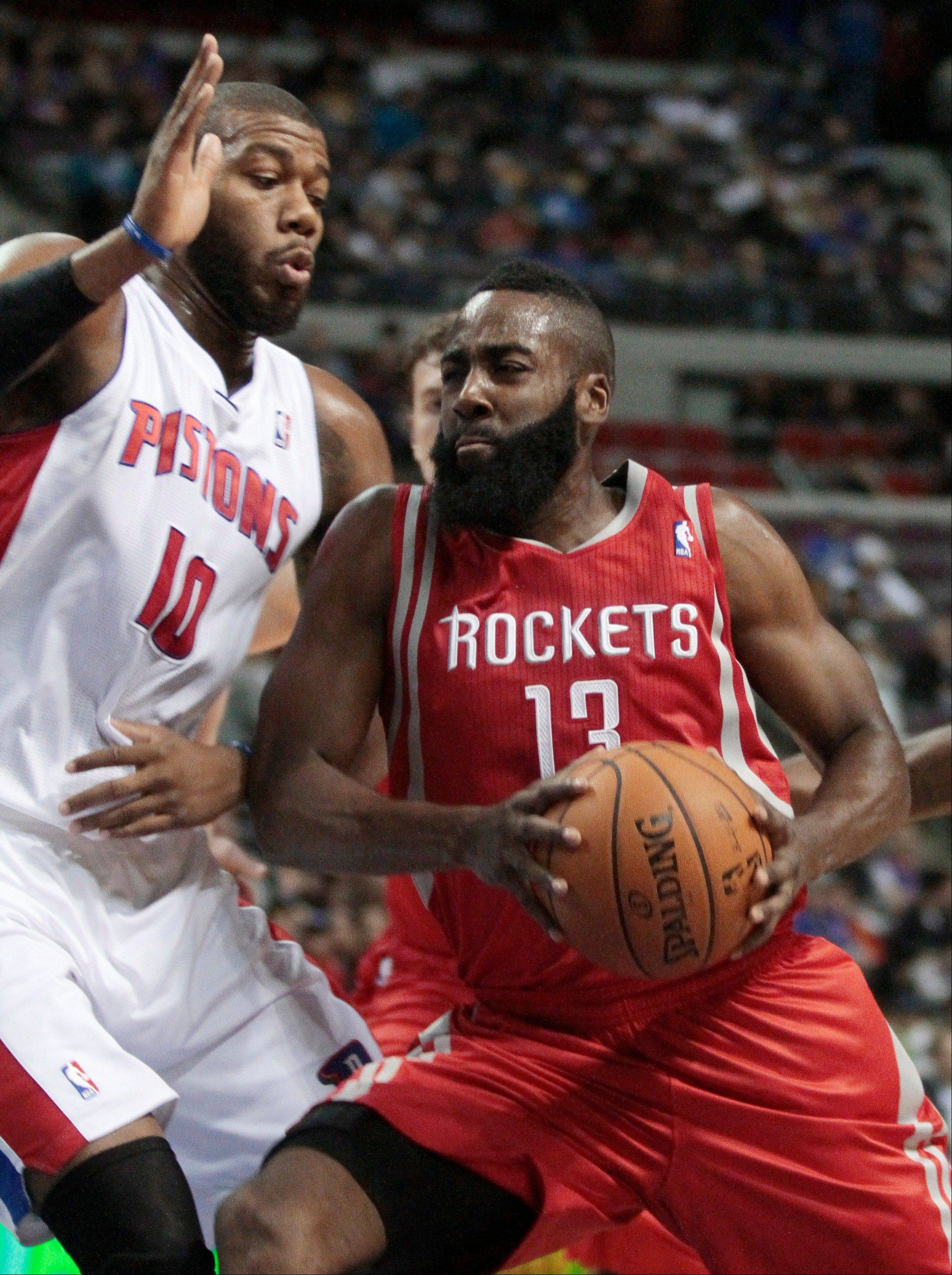 Houston Rockets guard James Harden drives to the basket against Detroit Pistons center Greg Monroe Wednesday during the first half in Detroit.