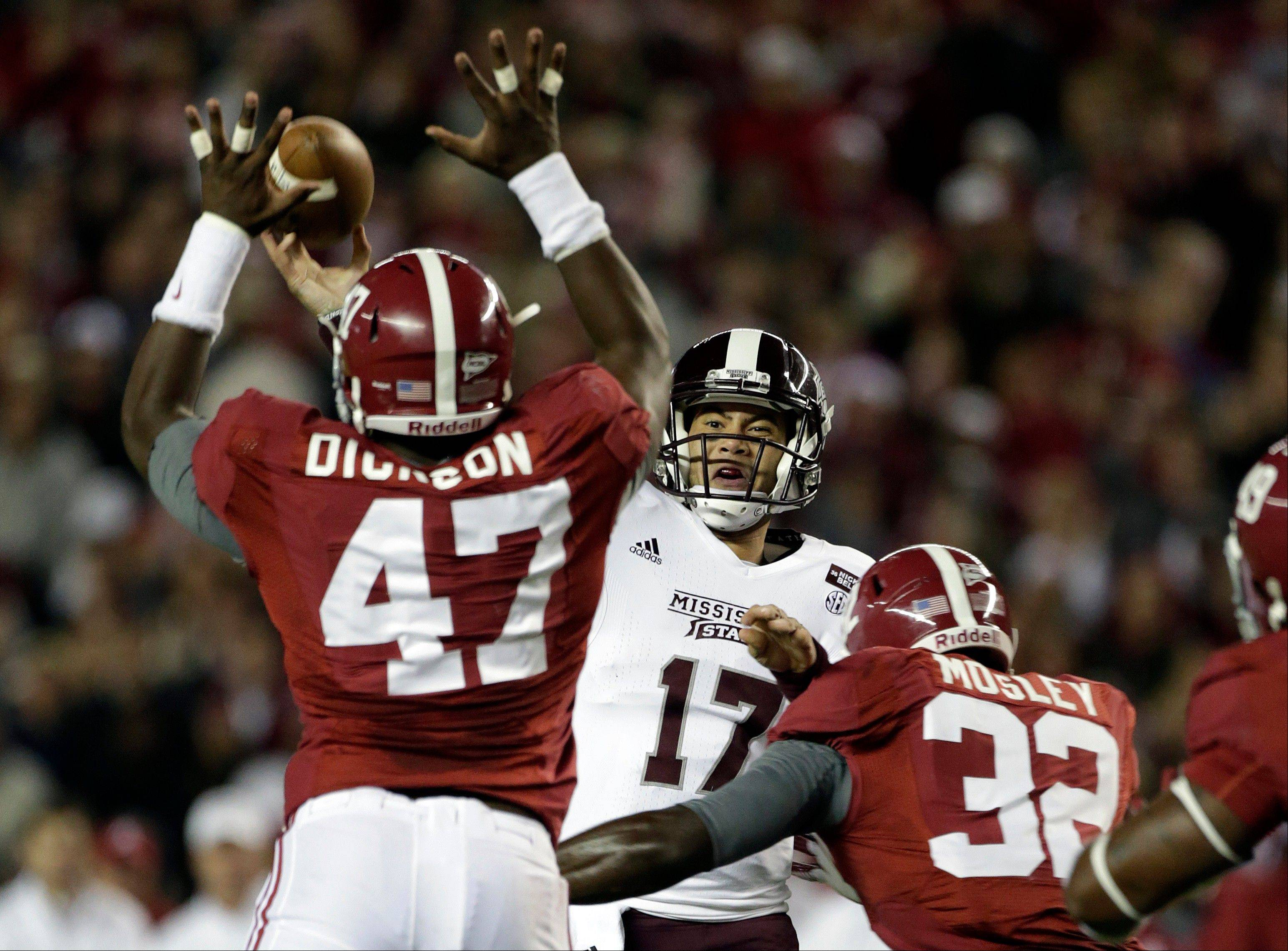 Mississippi State quarterback Tyler Russell (17) throws as he is rushed by Alabama linebacker Xzavier Dickson (47) and linebacker C.J. Mosley (32) Saturday during the first half at Bryant-Denny Stadium in Tuscaloosa, Ala.