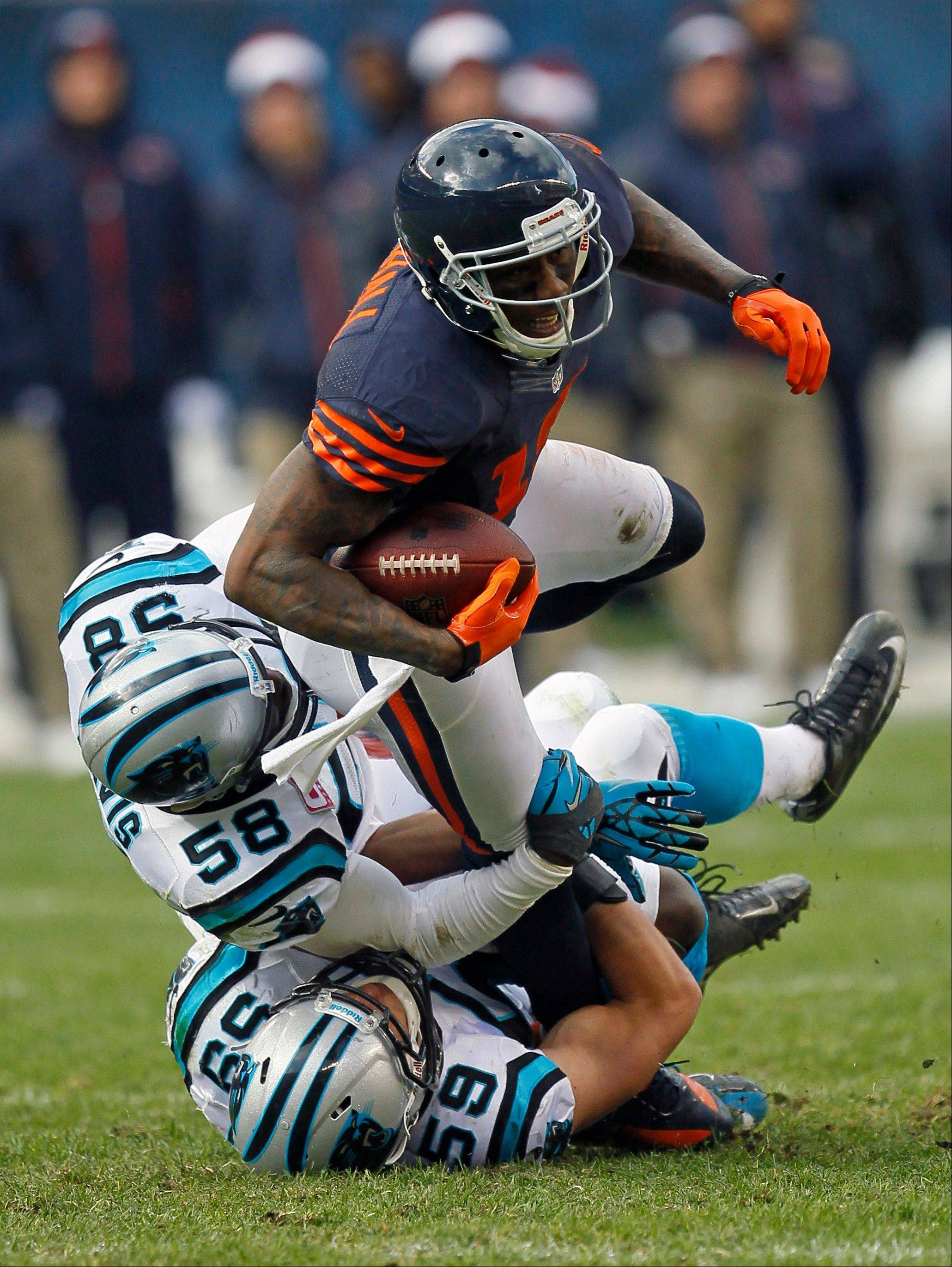 Bears wide receiver Brandon Marshall is tackled by Carolina Panthers linebackers Thomas Davis (58) and Luke Kuechly (59) Sunday after a reception during the second half.