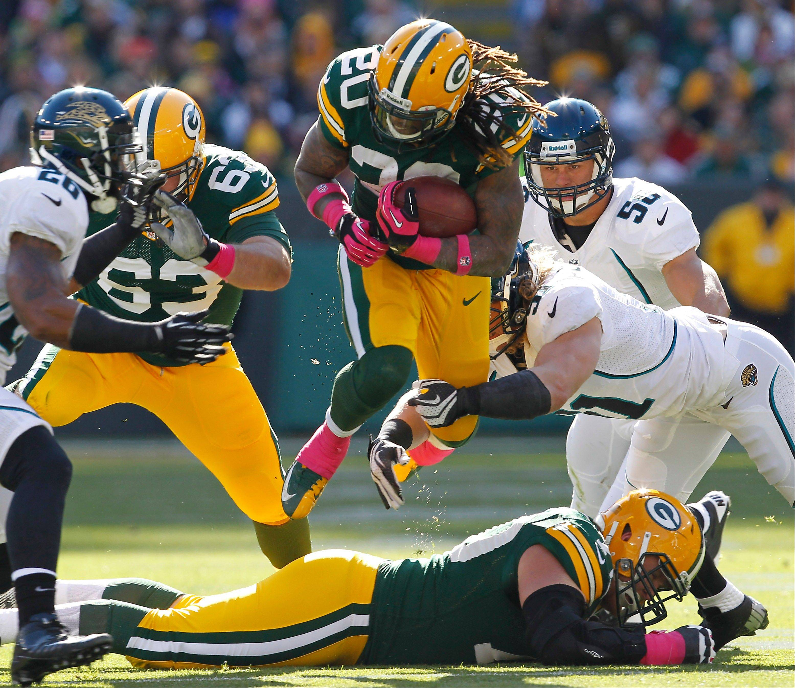 Jacksonville Jaguars middle linebacker Paul Posluszny tackles Green Bay Packers running back Alex Green Sunday. The Packers have a much needed bye week after they face Arizona.