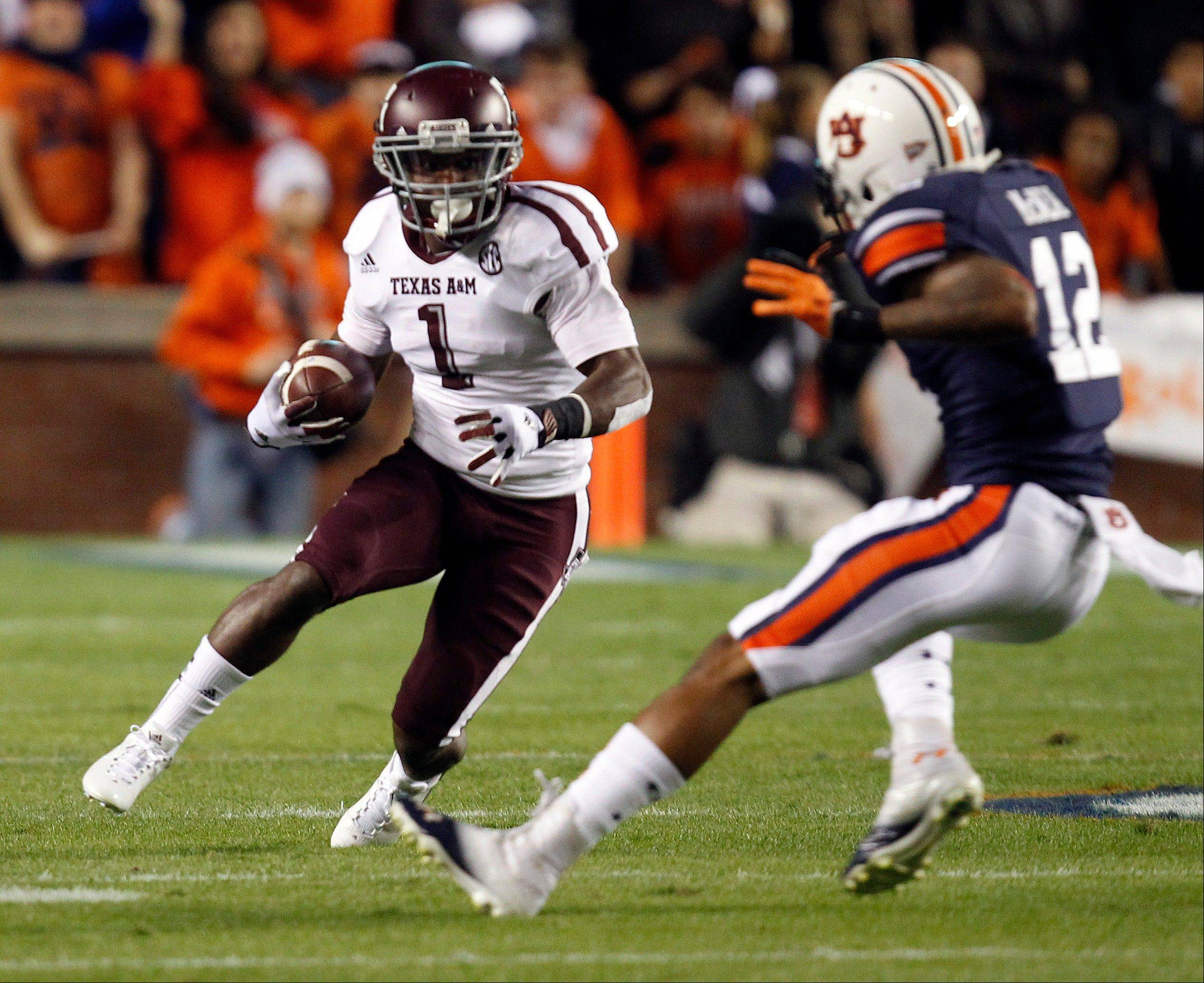 Texas A&M running back Ben Malena tries to get around Auburn defensive back Demetruce McNeal Saturday during the first half in Auburn, Ala. Texas A&M defeated Auburn 63-21.
