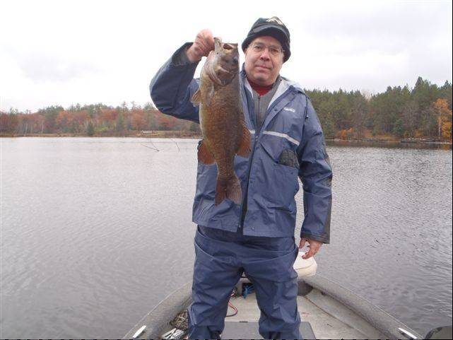 Les Mandlestein with a 5-pound smallmouth bass on a recent trip to the Menominee River near Crivitz, Wis., guided by Mike Mladenik.