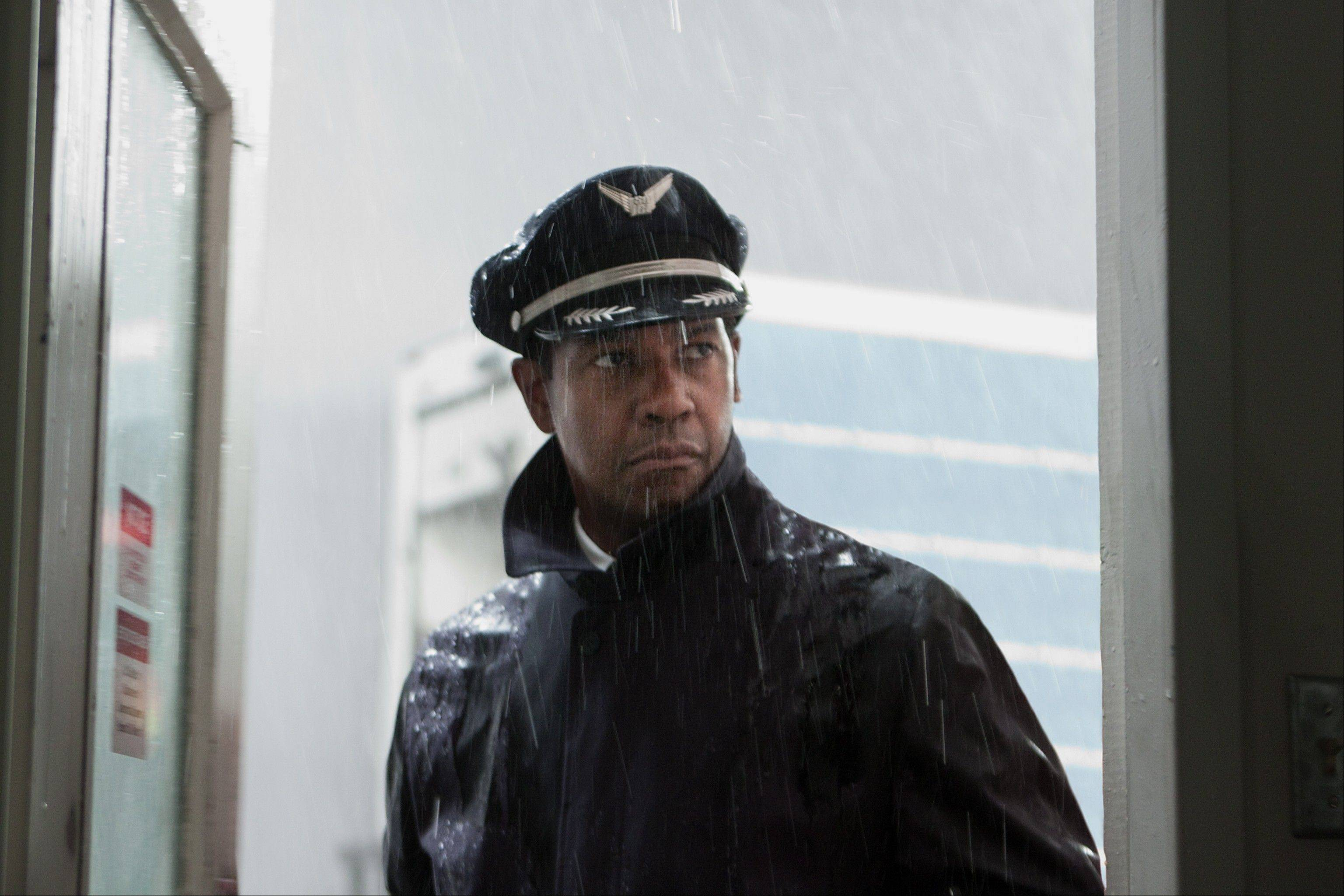 "Pilot Whip Whitaker (Denzel Washington) saves an airliner from catastrophe despite being hung over, drunk and coked-up in Robert Zemeckis' bold drama ""Flight."""