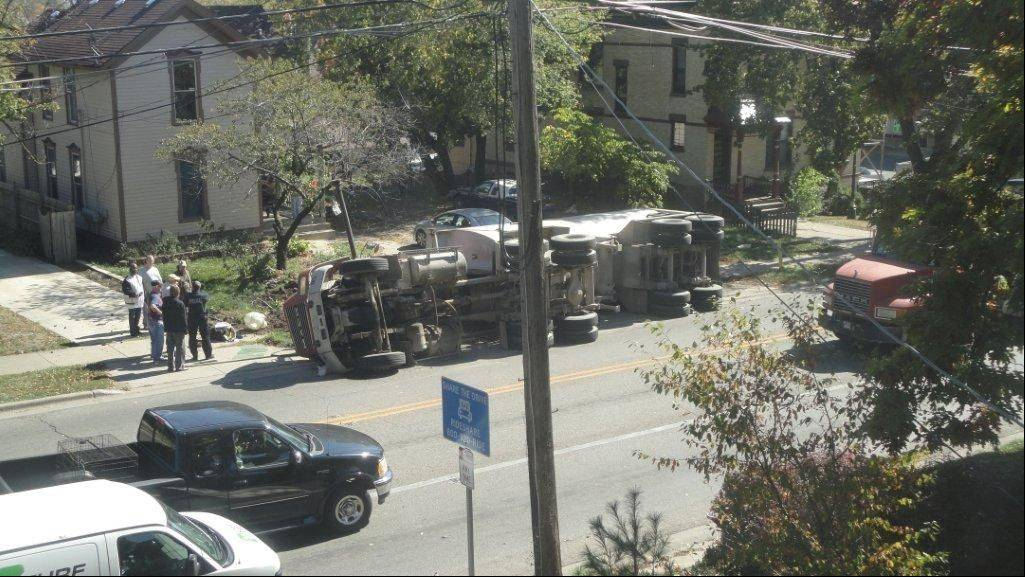 A truck tipped over Oct. 8 while traveling along Liberty Street. The driver was cited for driving too fast for conditions. Police said that was not necessarily because it was speeding, but because of an uneven load. Liberty Street residents are fighting to keep such trucks off their residential street.
