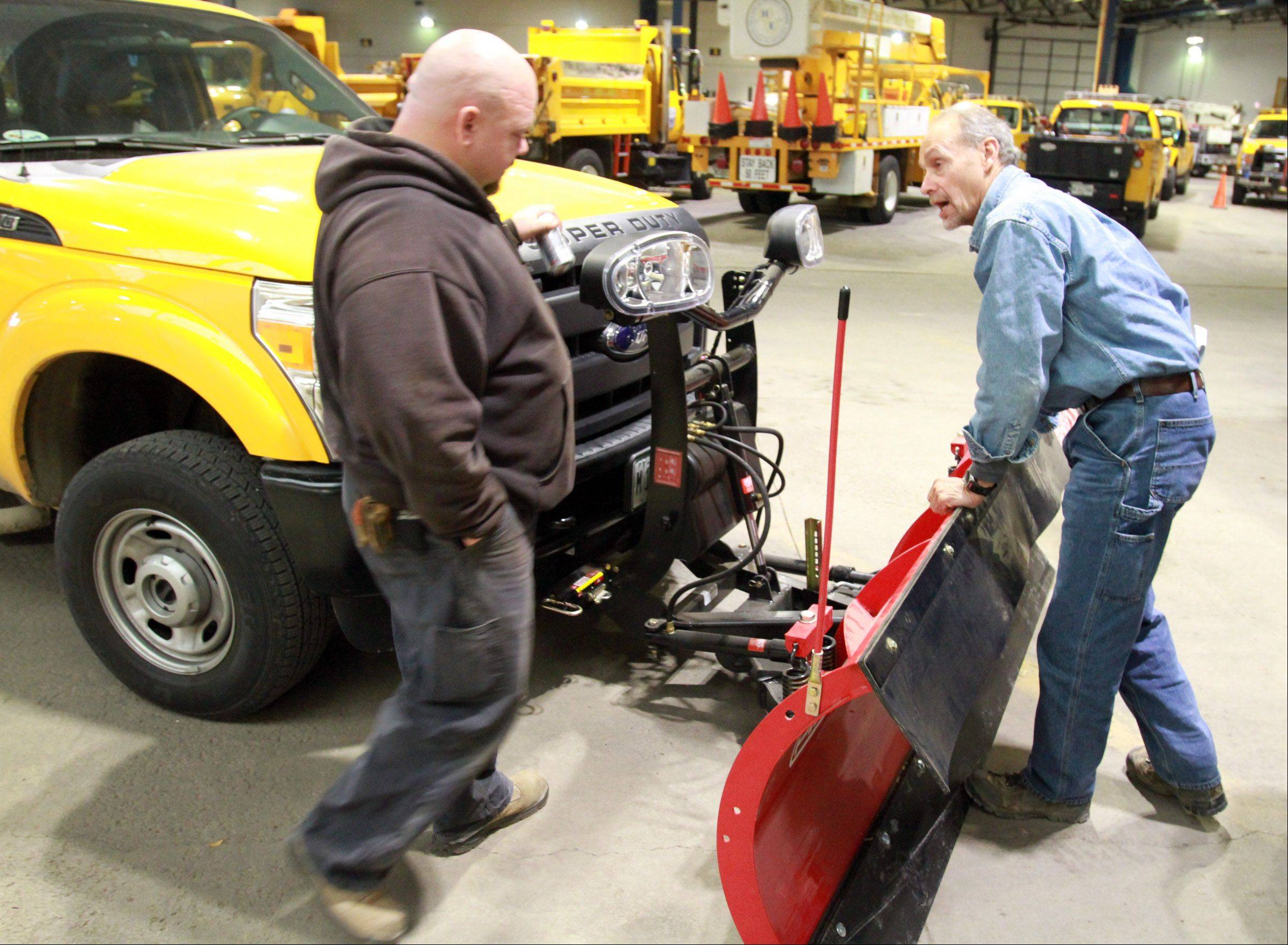 Hoffman Estates Public Works Department maintenance employees Chris Birdsell, left, and Steve Weber talk during snow and ice control training the village�s public works department Thursday.