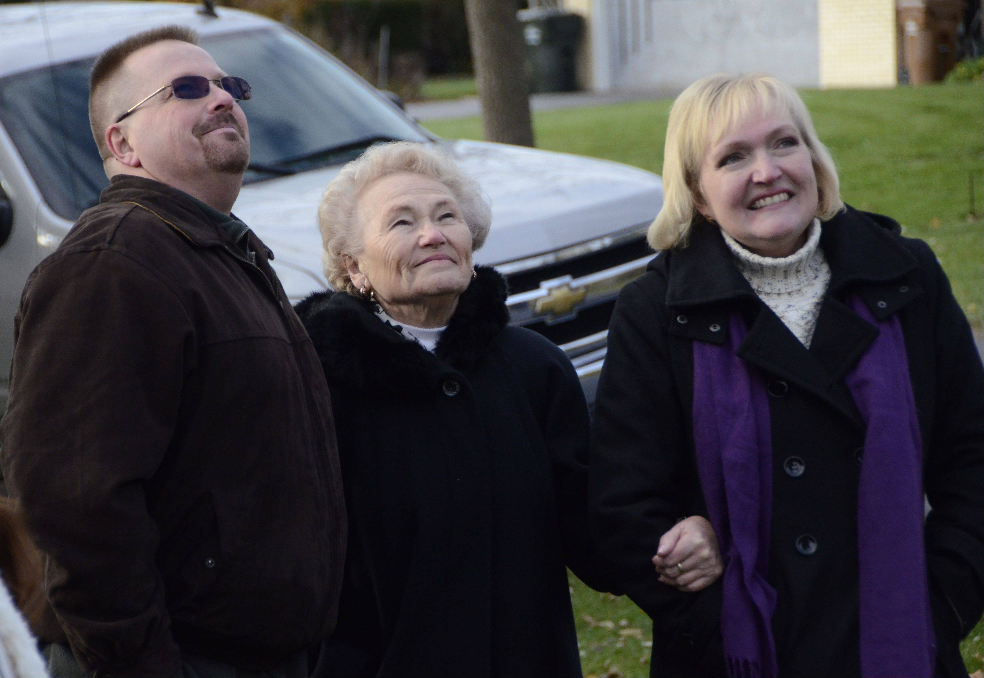 Barbara Theiszmann, center, of Prospect Heights watches with son, Tony Theiszmann of McHenry, and daughter, Kathy Patton of Wheaton, as their tree is lowered onto a truck headed to Chicago, where it will serve as the city's official Christmas tree.