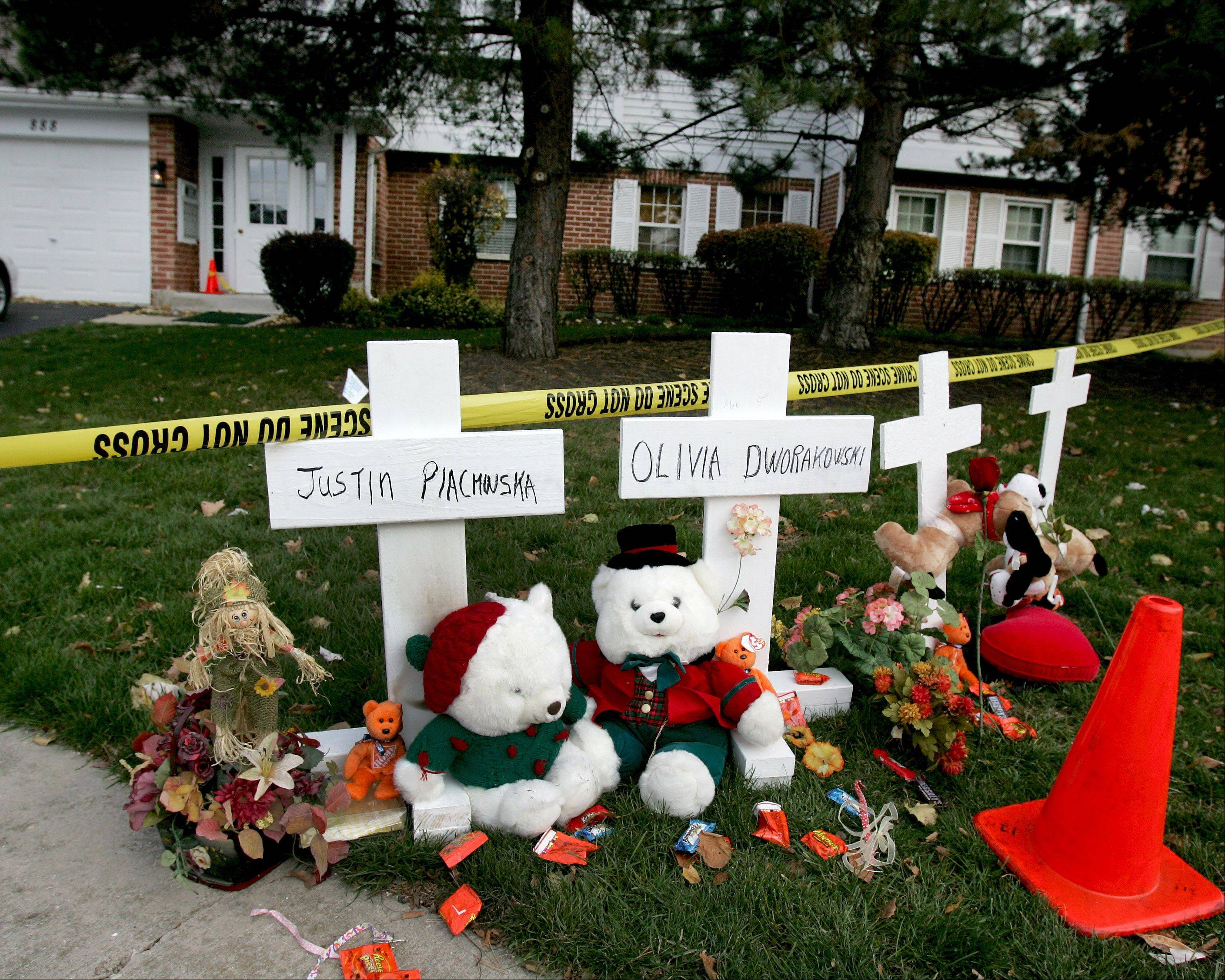 A makeshift memorial was set up near the Naperville home where Elzbieta Plackowska is accused of stabbing to death her 7-year-old son and a 5-year-old girl in her care.