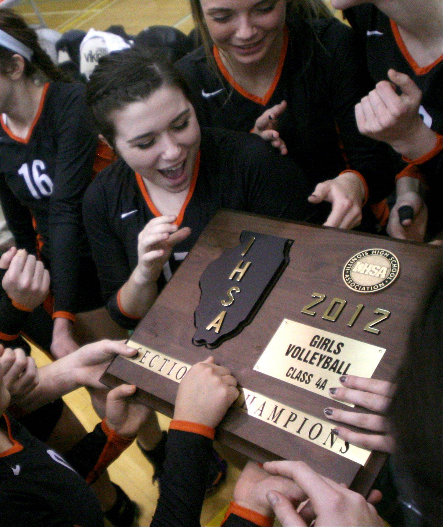 Libertyville players admire their trophy following a sectional final win over Palatine at Fremd High School on Thursday night.