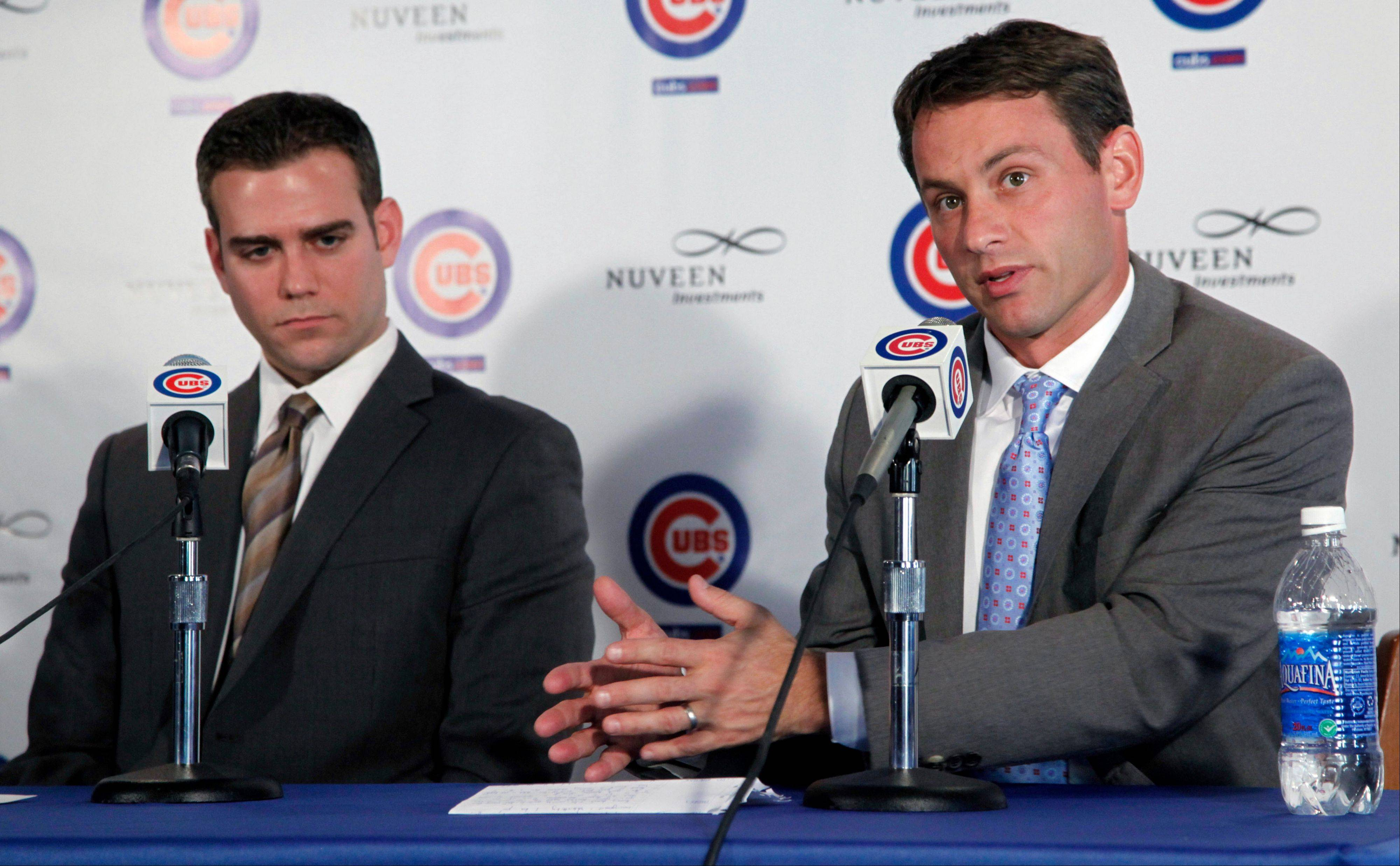 Cubs president Theo Epstein, left, and general manager Jed Hoyer have targeted starting pitchers as an off-season priority.