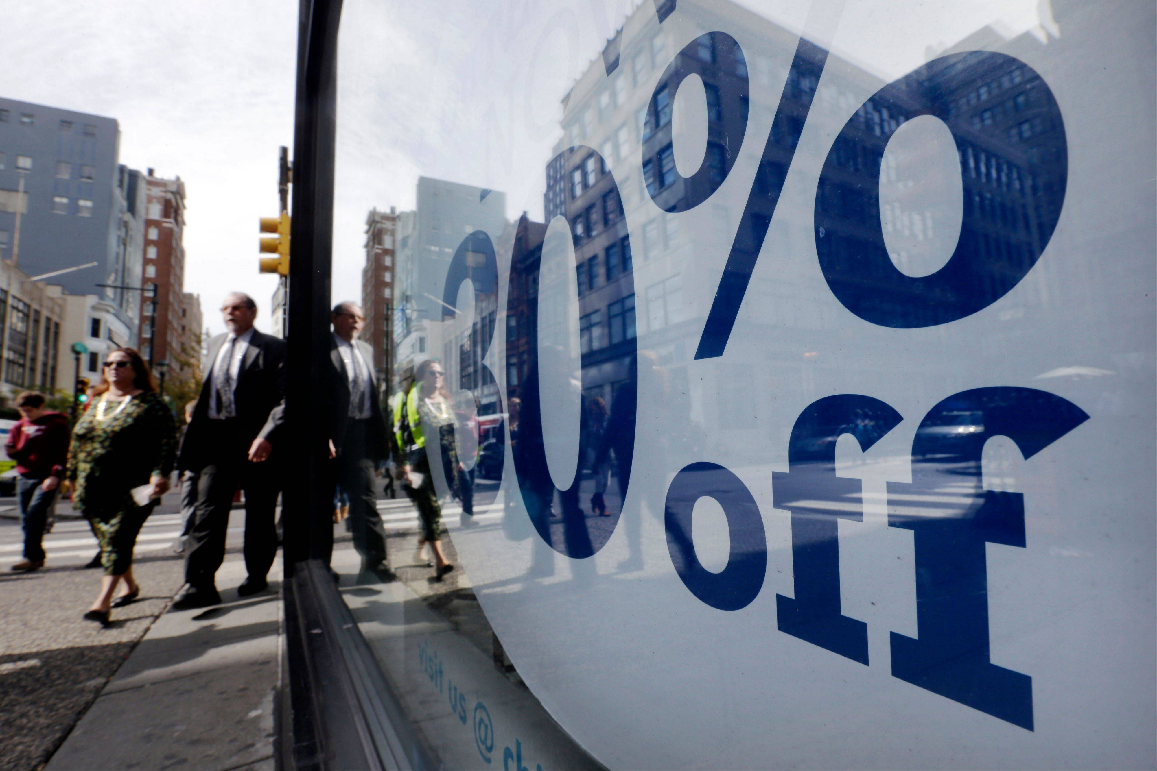 A flurry of reports Thursday showed that U.S. consumers are growing more confident and spending more, boosting a still-weak economy just five days before the presidential election.