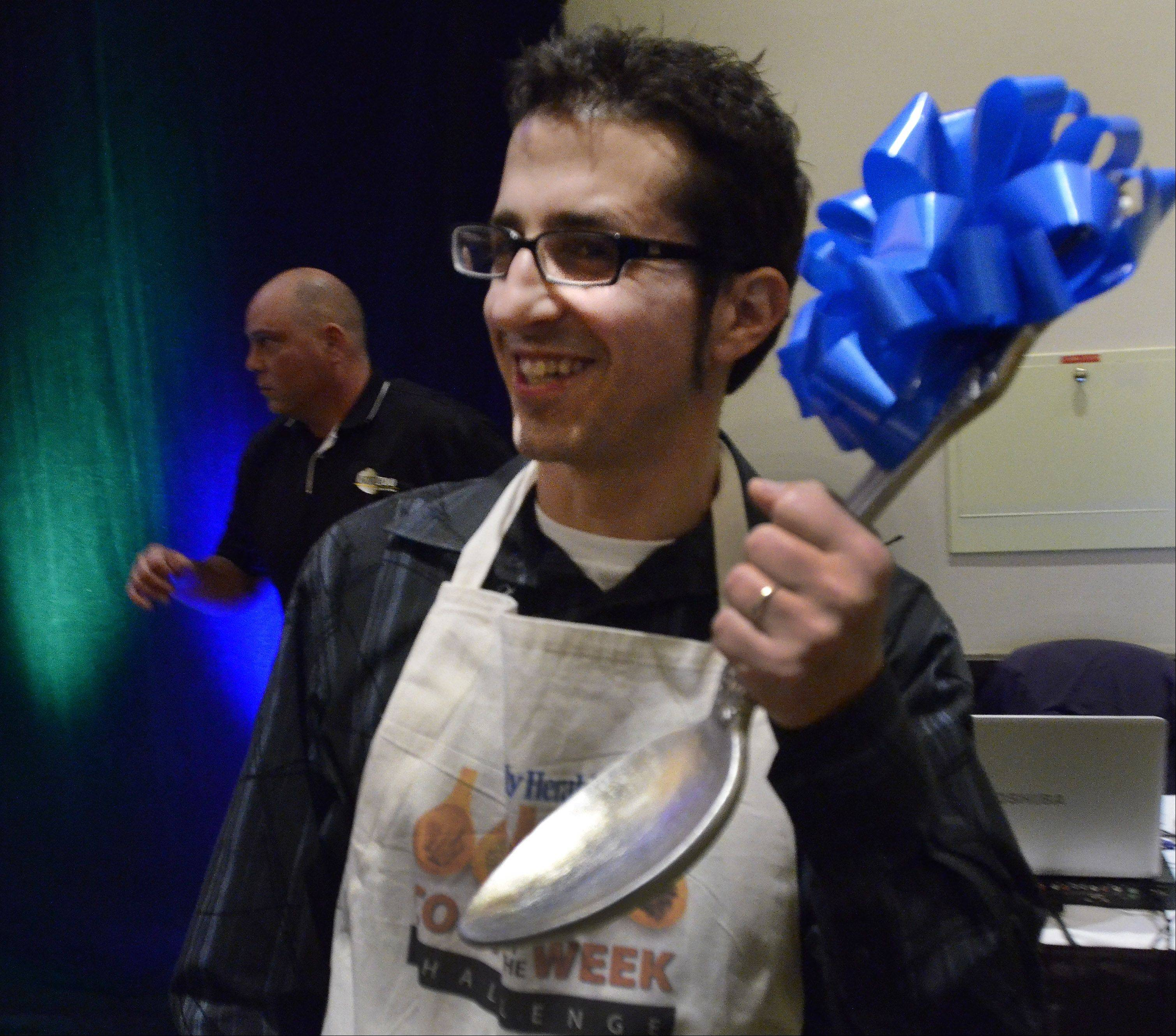 Michael Pennisi of Carpentersville is named Cook of the year 2012 after winning the Cook of the Week Challenge Cookoff with his dish Salmon Saute with spicy sweet potatoes and brussels slaw.