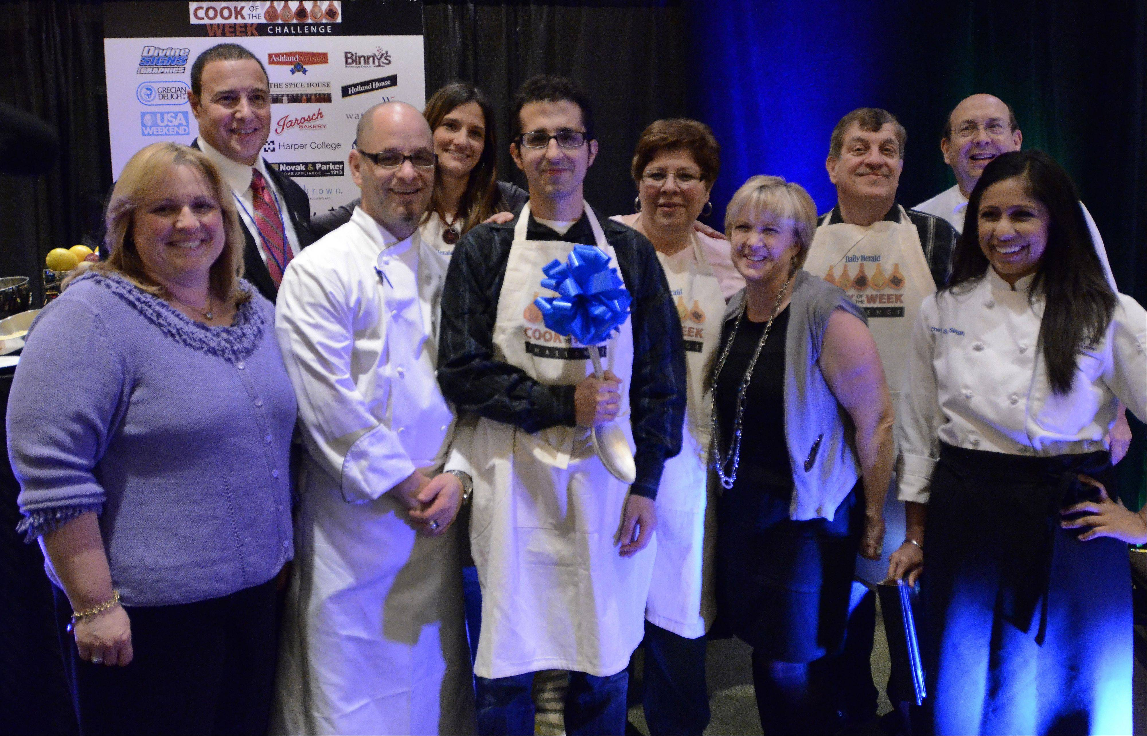 Standing in the center among contestants and judges is Michael Pennisi of Carpentersville, named Cook of the year 2012 after winning the Cook of the Week Challenge Cookoff with his dish Salmon Saute with spicy sweet potatoes and brussels slaw.