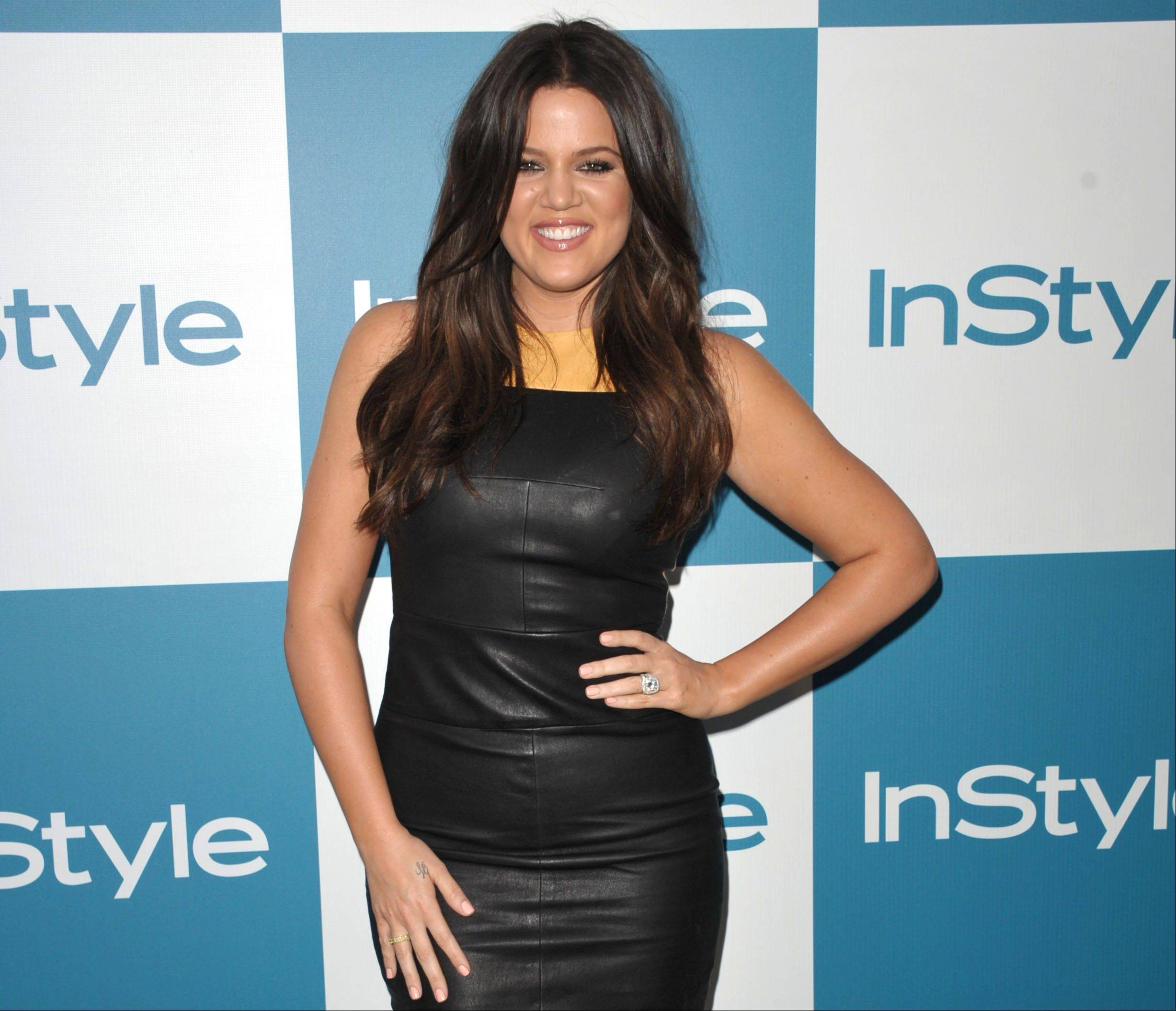 "New ""X Factor"" host Khloe Kardashian Odom came across like the novice she is on live TV, shouting her lines and making awkward small talk with contestants."