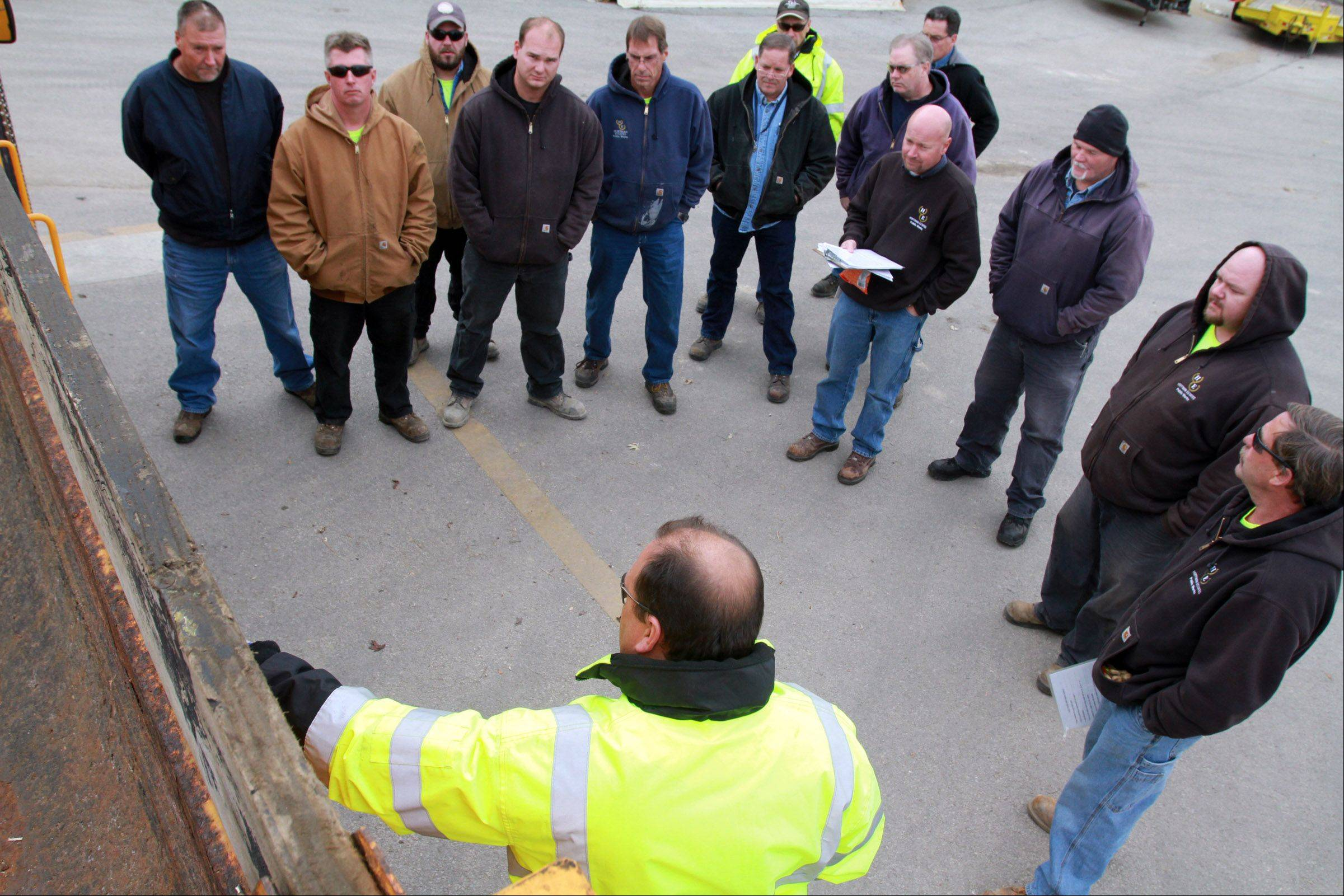 Hoffman Estates Public Works Department maintenance employee Jim Finn teaches drivers how to apply different liquid mixes to the roads to melt ice and snow during training Thursday.