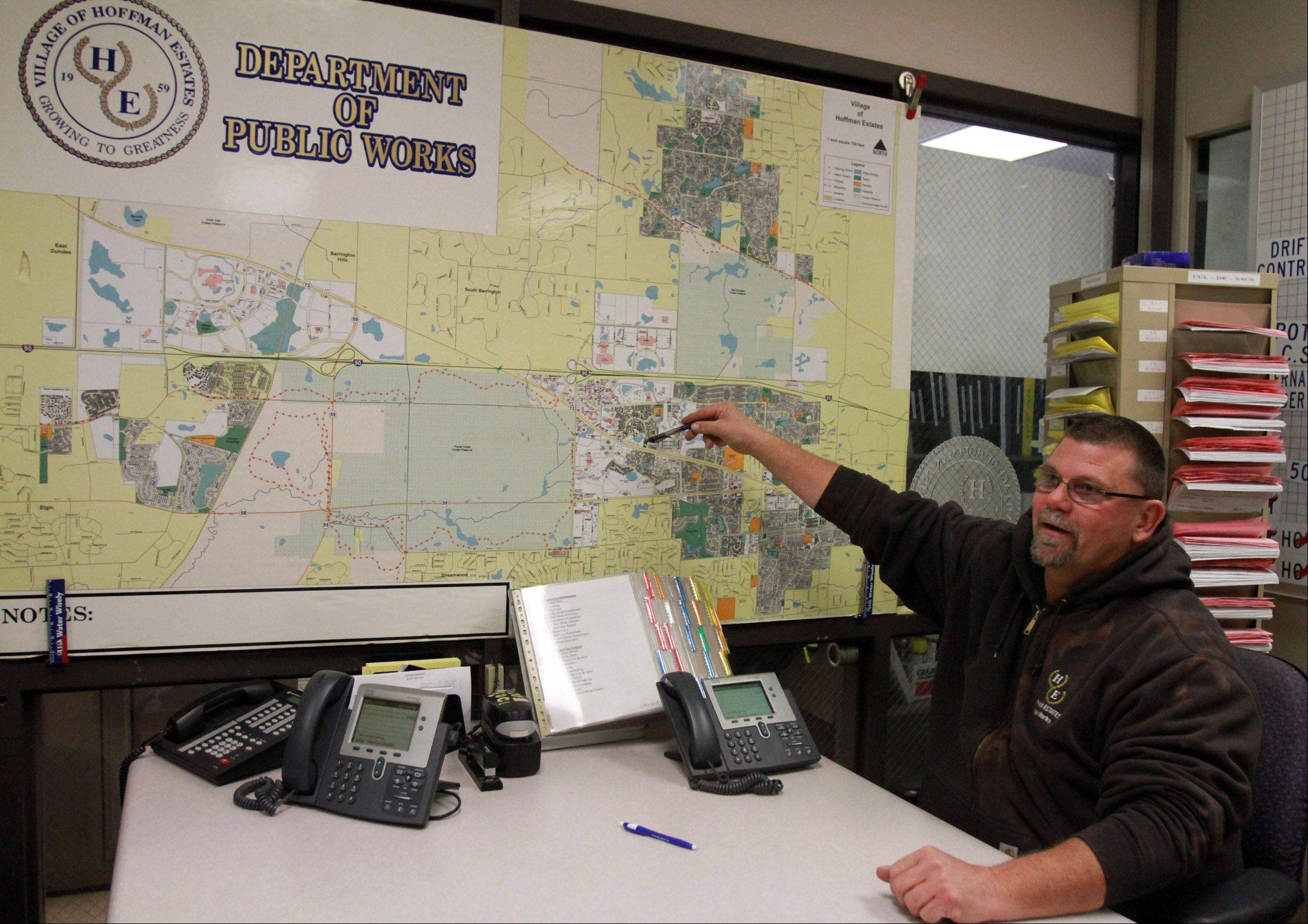 Joe Gawerecki, Hoffman Estates Public Works Department maintenance employee, points out parts of the village that can be difficult to plow during in-house snow and ice control training at the village's public works center on Thursday, Nov. 1.