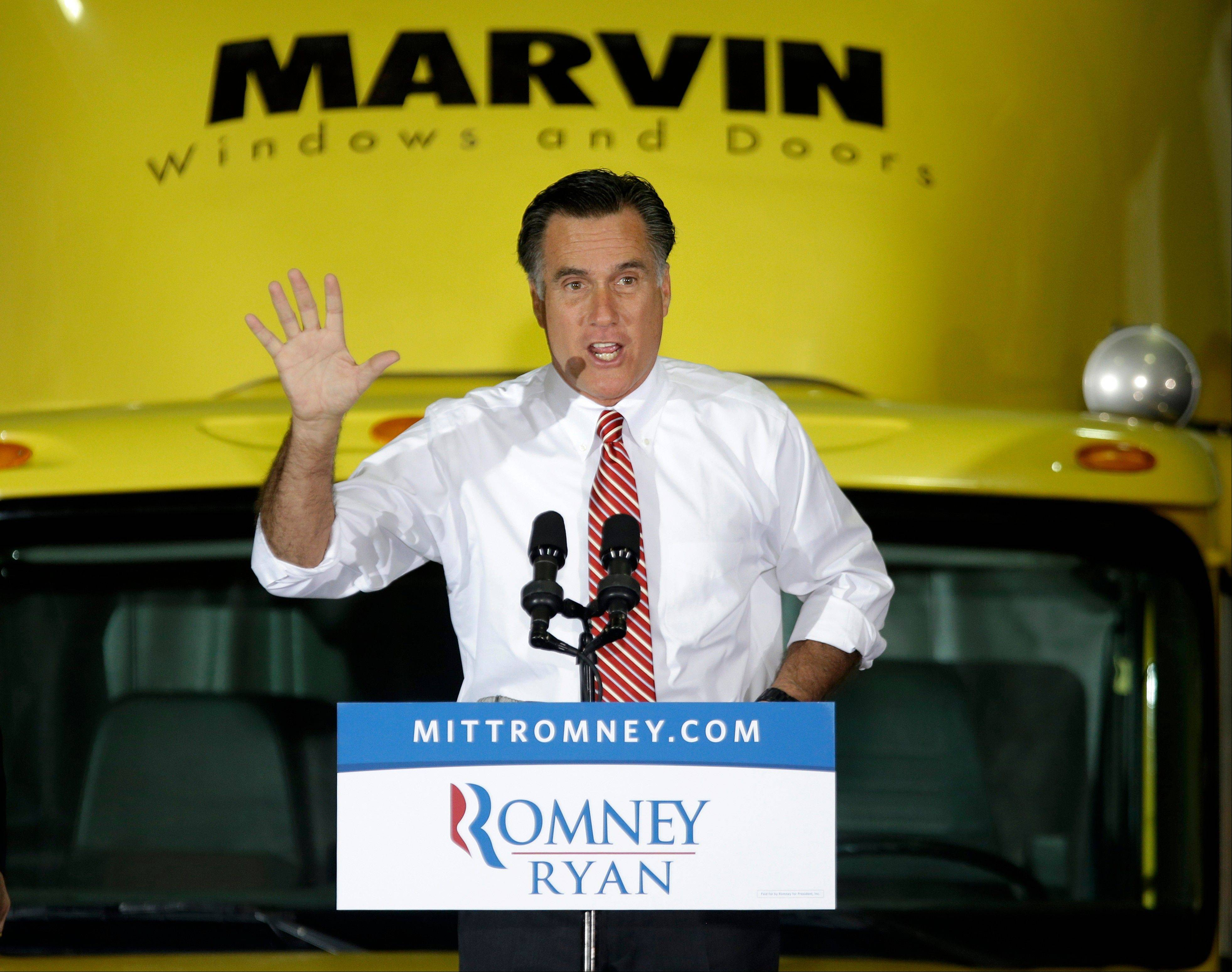 Republican presidential candidate, former Massachusetts Gov. Mitt Romney gestures while speaking at a campaign event at Integrity Windows in Roanoke, Va., Thursday, Nov. 1, 2012.