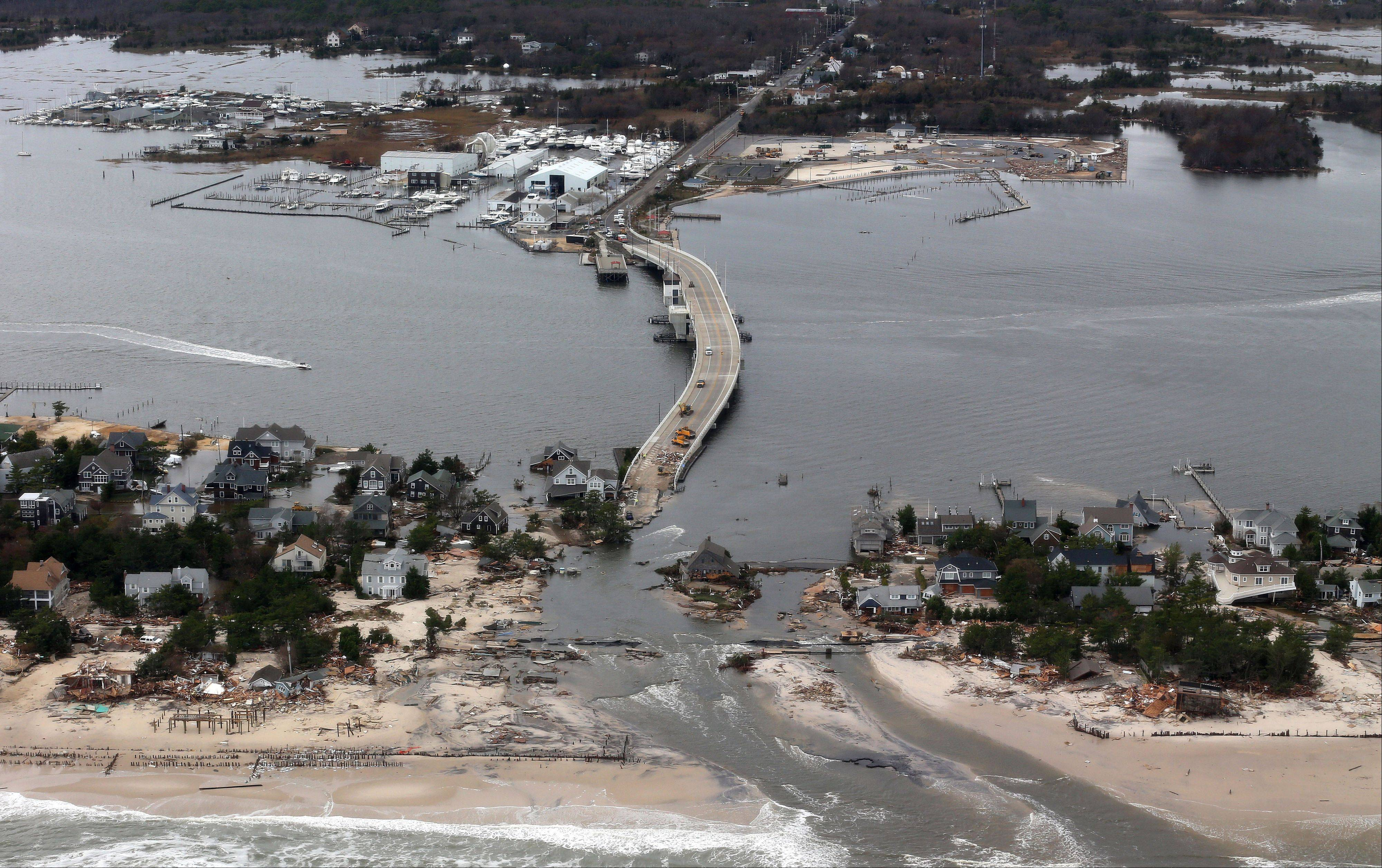 This aerial photo made from a helicopter shows storm damage from Sandy over the Atlantic Coast in Mantoloking, N.J., Wednesday, Oct. 31, 2012. The photo was made from a helicopter behind the helicopter carrying President Obama and New Jersey Gov. Chris Christie, as they viewed storm damage from superstorm Sandy.