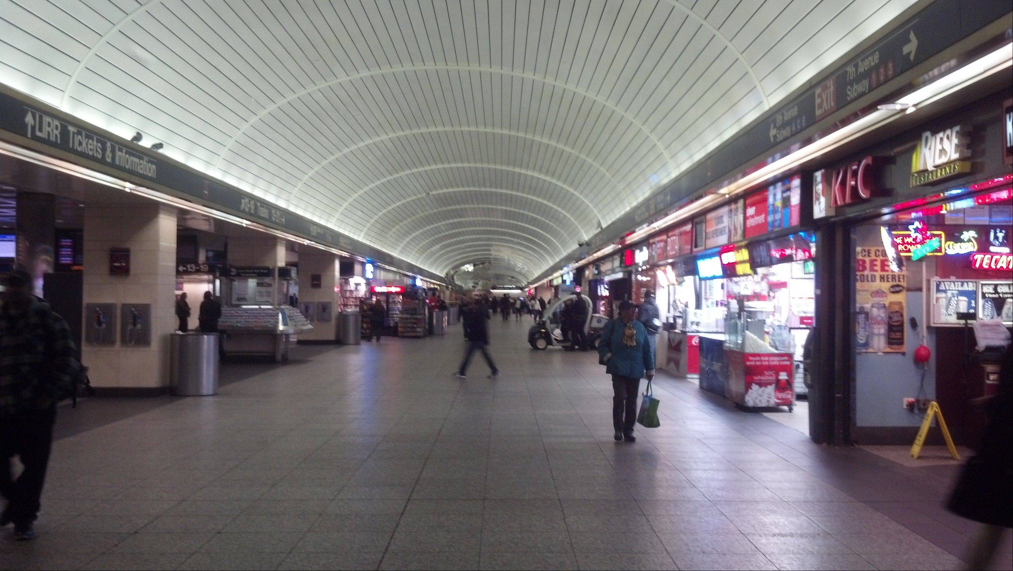 Morning commuters walk through a near empty Penn Station in New York, during the morning rush hour on Thursday. As commuters tried to get back to a normal pace, trains in Manhattan ran only north of 34th Street, unable to travel through flooded tunnels in downtown Manhattan and Brooklyn.