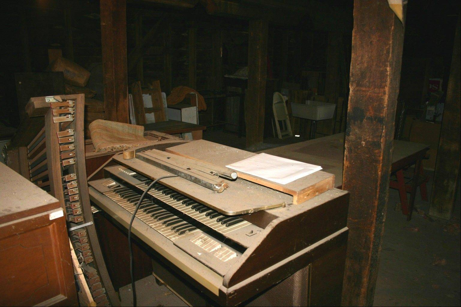 This organ was played in the Illinois state house. DeLoris Doederlein plans to keep this item from the warehouse.
