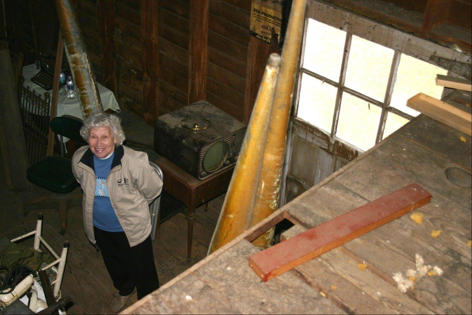DeLoris Doederlein stands on the first floor of the former Doederlein Lumber Co. warehouse. Through the decades it has stored items local residents have had no room for in their homes. The warehouse is slated to be demolished when she donates it to the village of East Dundee.