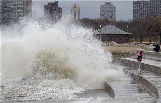 Waves fueled by Sandy's winds crash into Chicago's lakefront.
