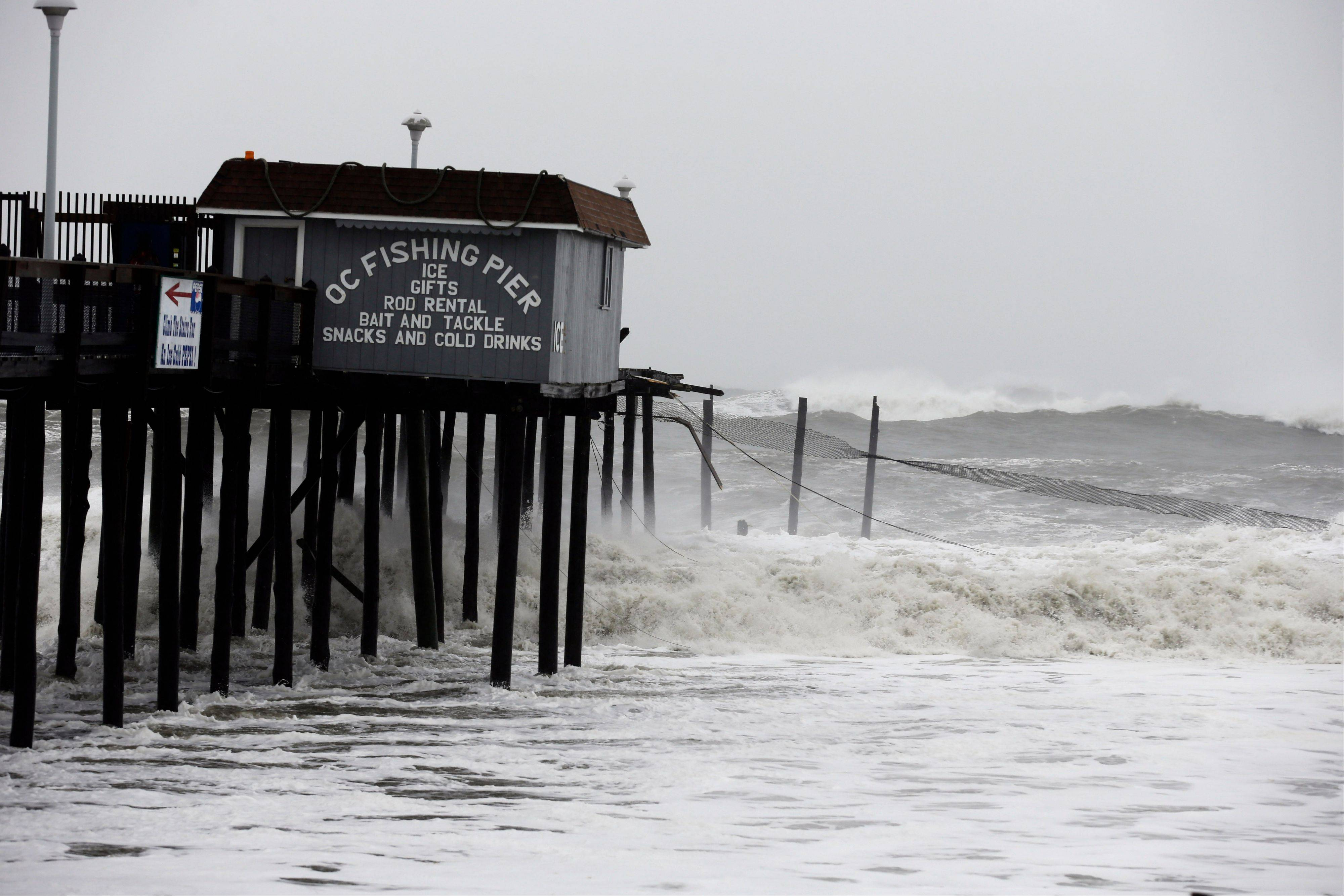 Part of the fishing pier in Ocean City, Md., is ripped away during Hurricane Sandy's assault on the East Coast.