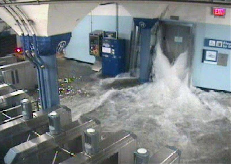 In this photo provided by the Port Authority of New York and New Jersey, a surveillance camera captures the PATH station in Hoboken, N.J., as it is flooded Monday night during the advance of Hurricane Sandy.