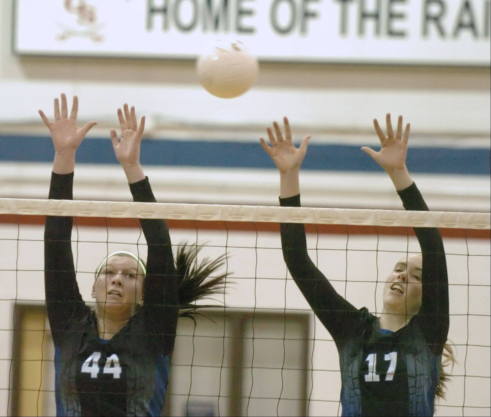 Maddie Haggerty,left, and Mary Boken of St. Francis go up for a block during the St. Francis vs. Joliet Catholic at Glenbard South Thursday. This was a the Class 3A Sectional Final.