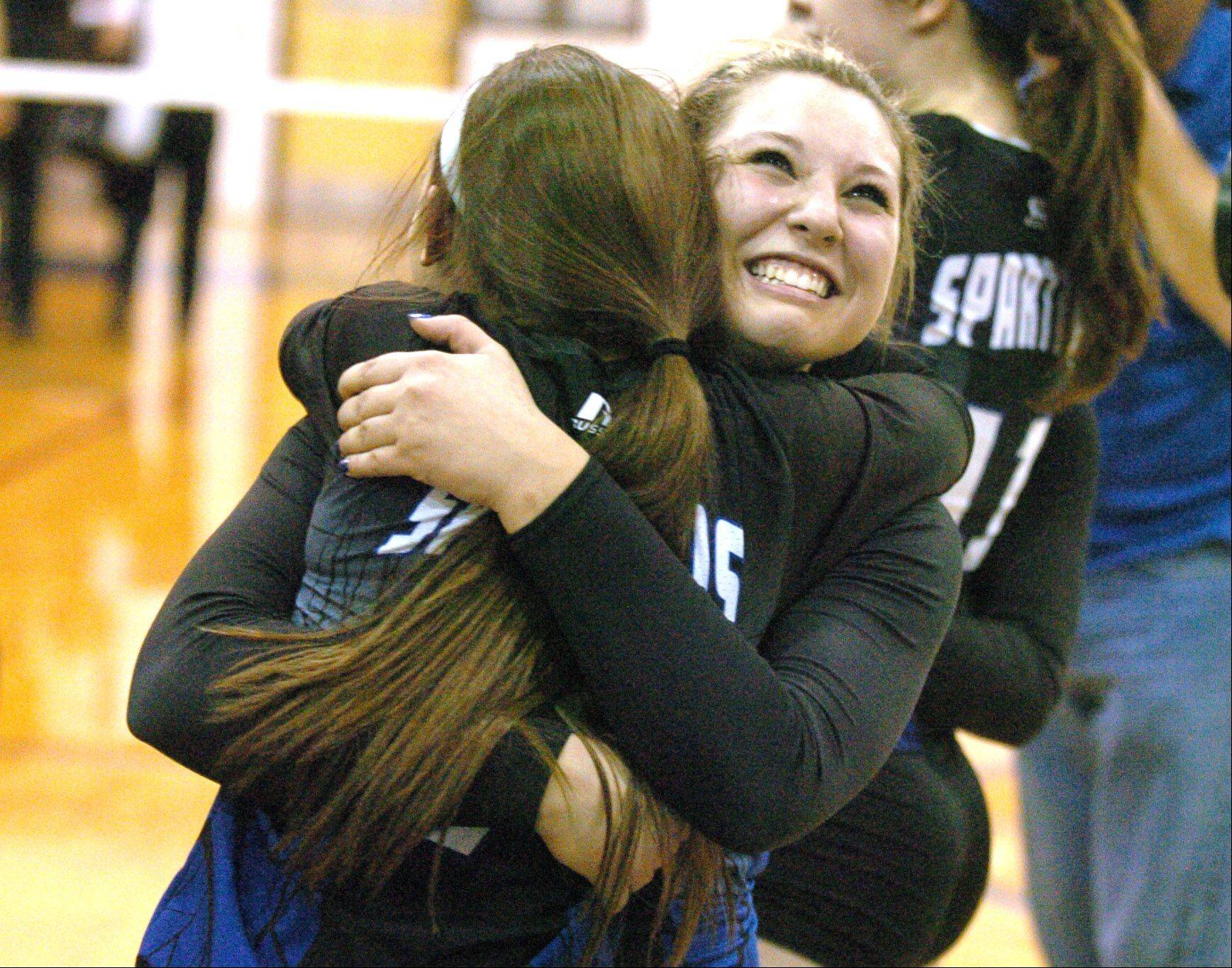 Natalie Murison,left, hugs Kristin Acciavatti after their big win during the St. Francis vs. Joliet Catholic game at Glenbard South Thursday. This was a the Class 3A Sectional Final.