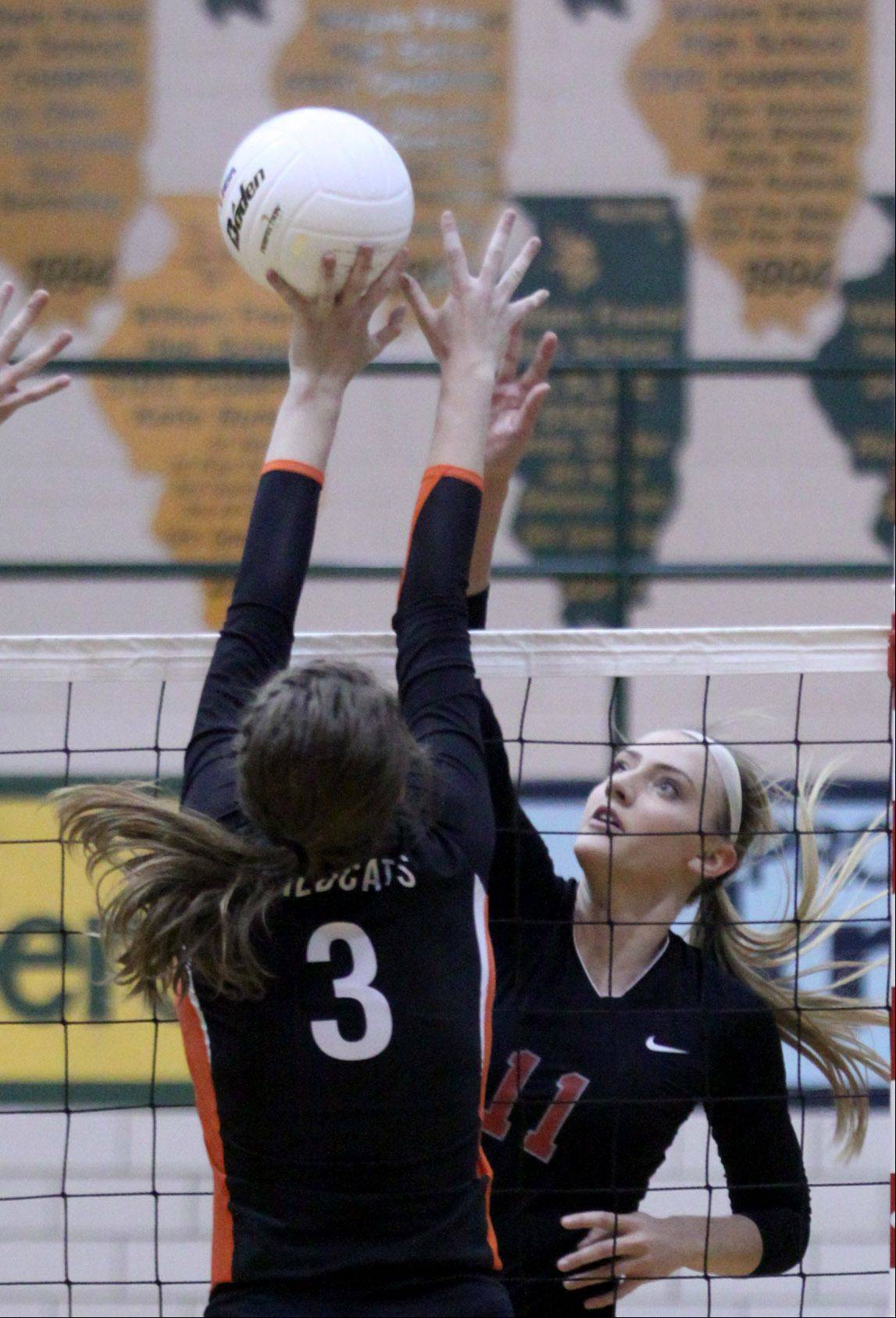 Libertyville's Taylor Zant, left, prepares to block Palatine's Taylor Fricano, right, during a sectional title action at Fremd on Thursday night.