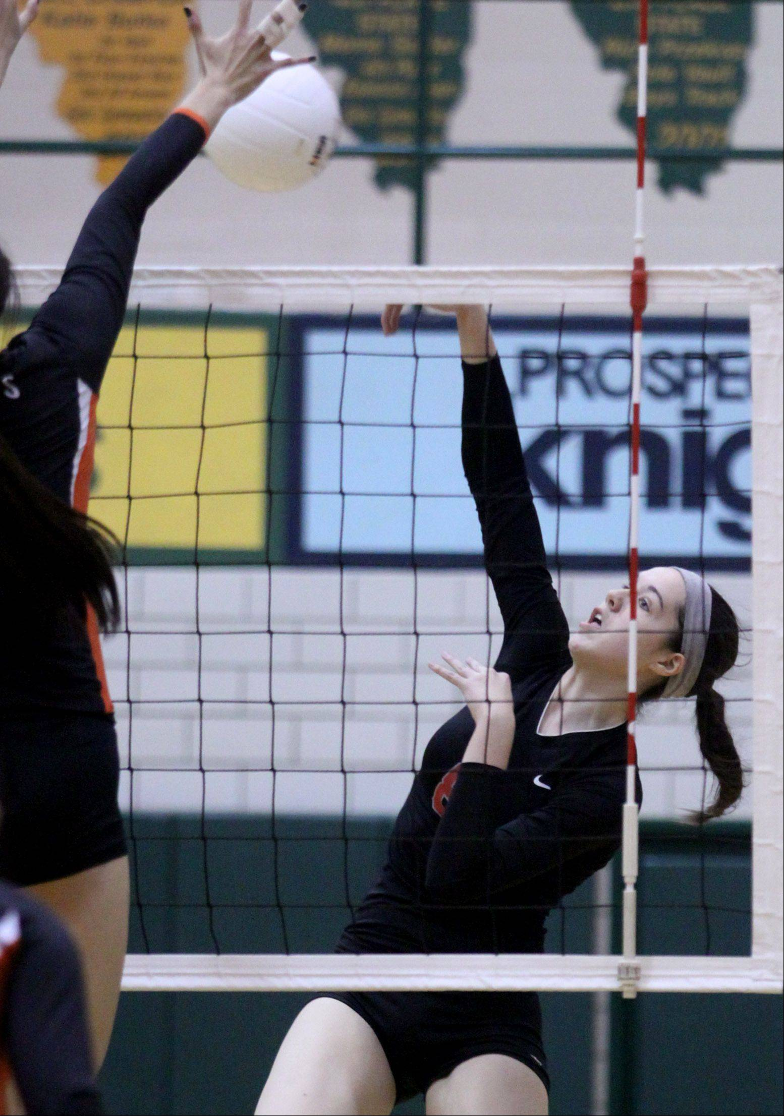 Palatine's Val Soderstrom blasts the ball over the net against Libertyville during a sectional title action at Fremd High on Thursday night.