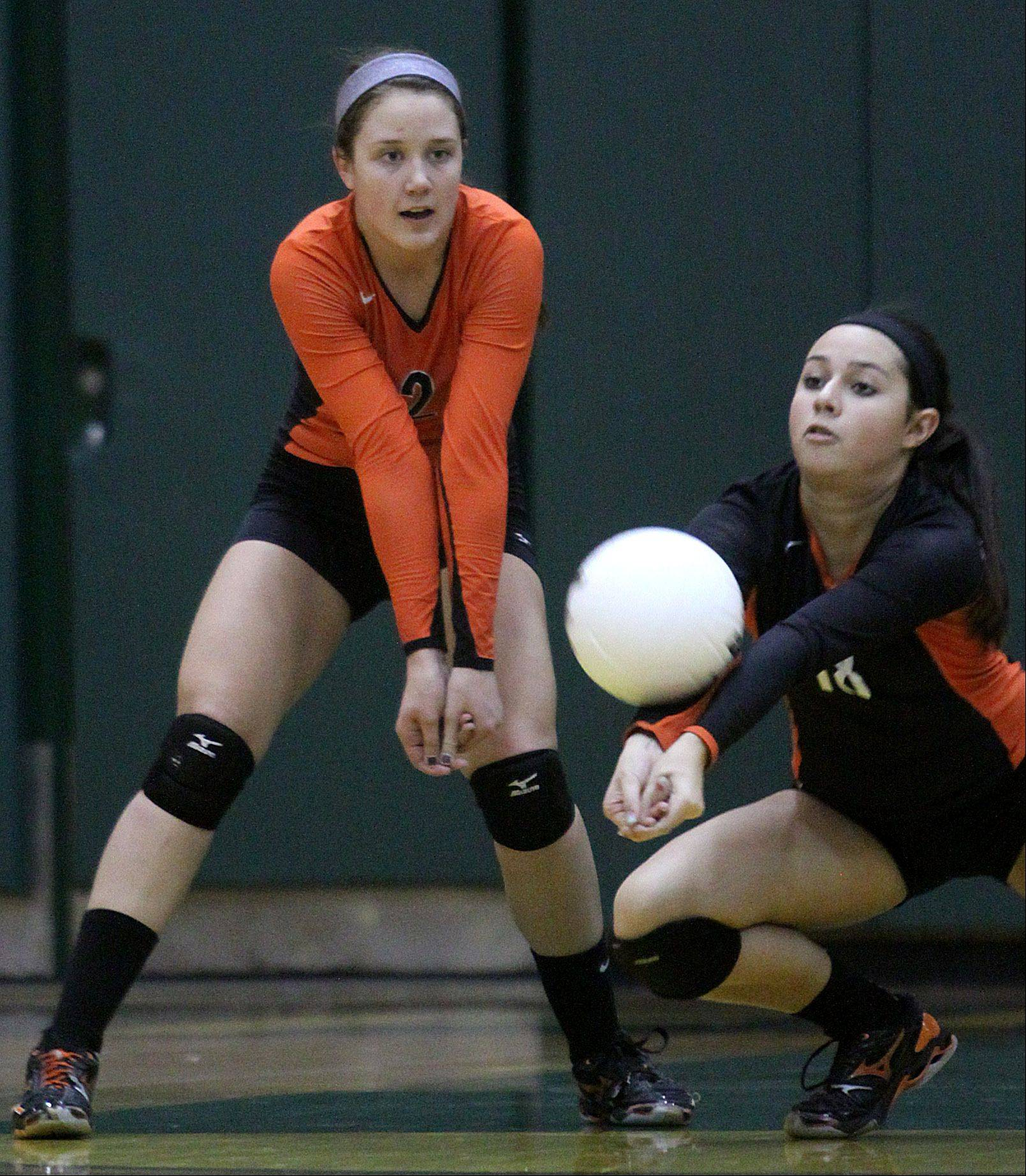 Libertyville's Brooke Donovan, right, lunges for the ball as teammate Kristen Webb, left, keeps an eye on the action during sectional title action against Palatine at Fremd on Thursday night.