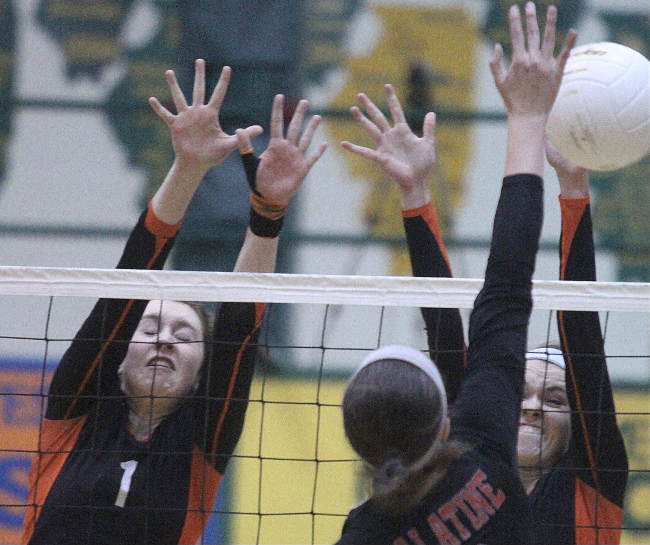 Libertyville's Alex Basler, left, and Rhiannon Prentiss, right, block Palatine's Val Soderstrom, center, during sectional title play at Fremd on Thursday night.