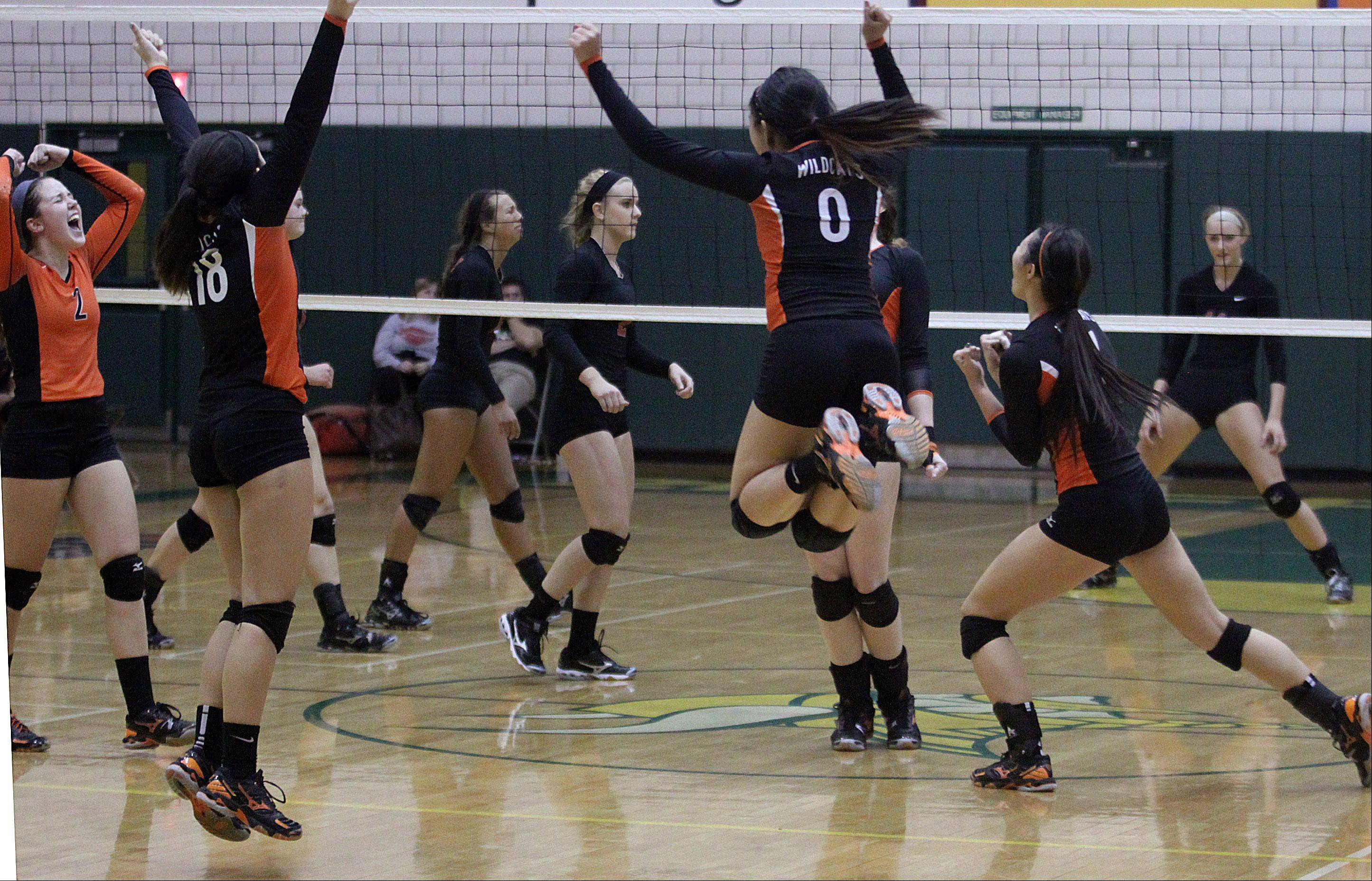 Libertyville's players erupt with celebration as Palatine's players walk off the court at Fremd on Thursday night.